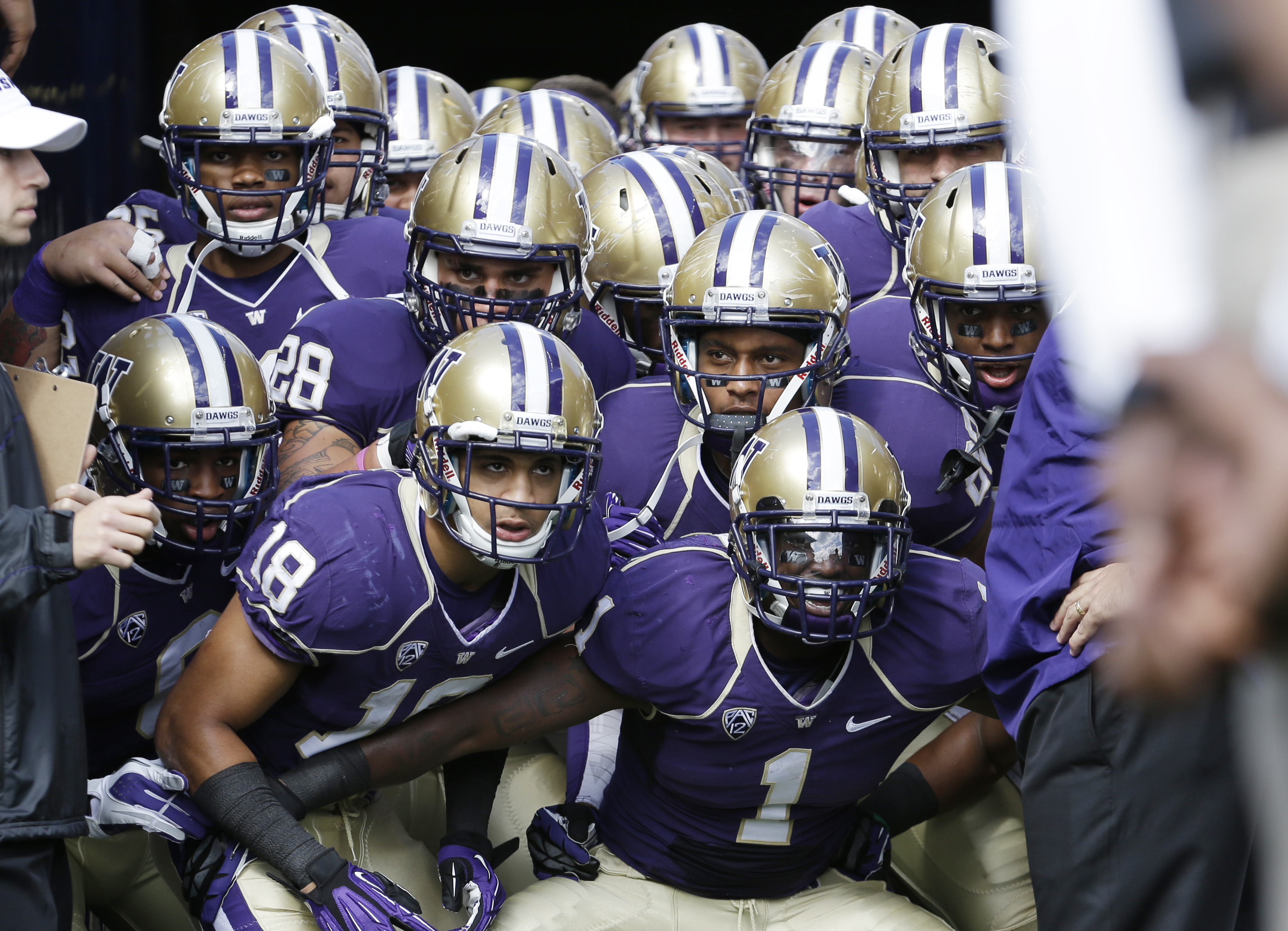 Washington players wait in their tunnel to take to the field before a game against Idaho State in Seattle.  (Elaine Thompson/Associated Press)