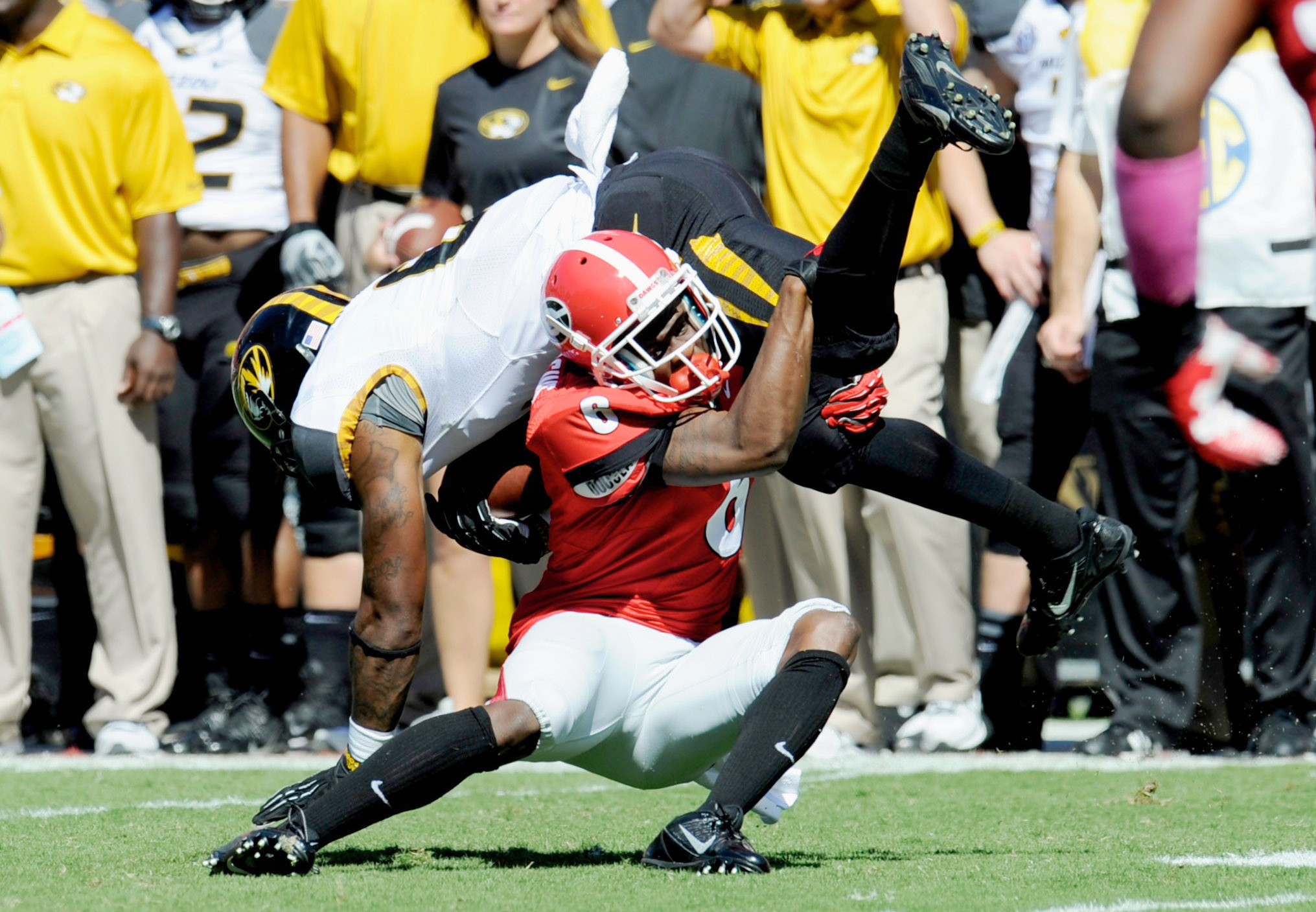 Georgia Bulldogs cornerback Shaq Wiggins (6) tackles Missouri Tigers running back Marcus Murphy (6) during the second quarter at Sanford Stadium. Mandatory Credit: Dale Zanine-USA TODAY Sports