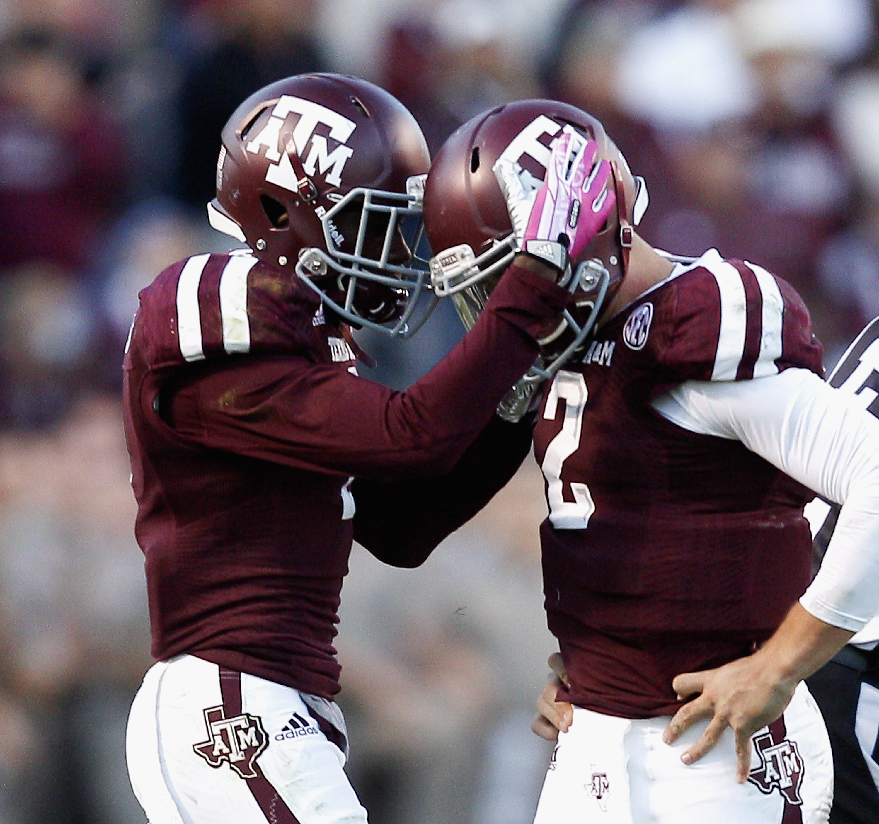 Texas A&M quarterback Johnny Manziel (2) is consoled by running back Ben Malena (1) after he was sacked on their final play in the fourth quarter against Auburn in an NCAA college football game Saturday, Oct. 19, 2013, in College Station, Texas. Auburn won 45-41. (AP Photo/Bob Levey)