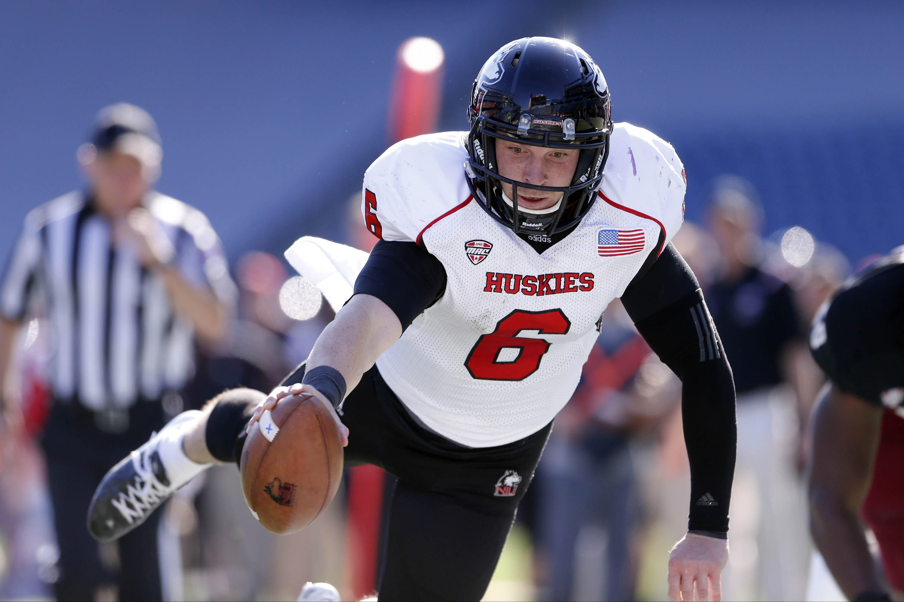 Northern Illinois Huskies quarterback Jordan Lynch (6) scores a touchdown against the Massachusetts Minutemen during the first quarter at Gillette Stadium. (David Butler II/USA TODAY Sports)
