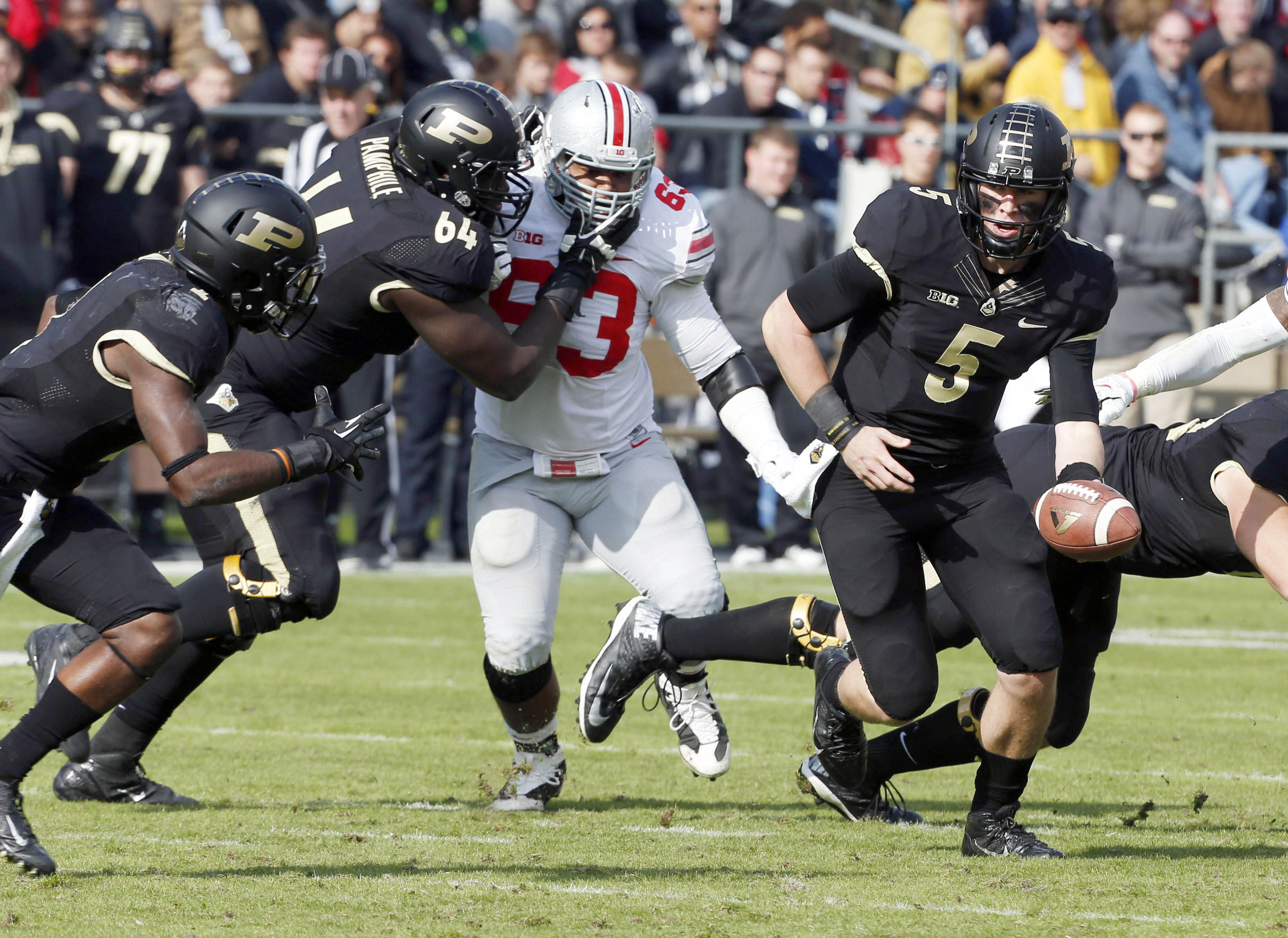 Nov 2, 2013; West Lafayette, IN, USA; Purdue Boilermakers quarterback Danny Etling (5) hands the ball off as Ohio State Buckeyes linebacker Ryan Shazier (2) breaks through the line of scrimmage at Ross Ade Stadium. Ohio State defeats Purdue 56-0. Mandatory Credit: Brian Spurlock-USA TODAY Sports