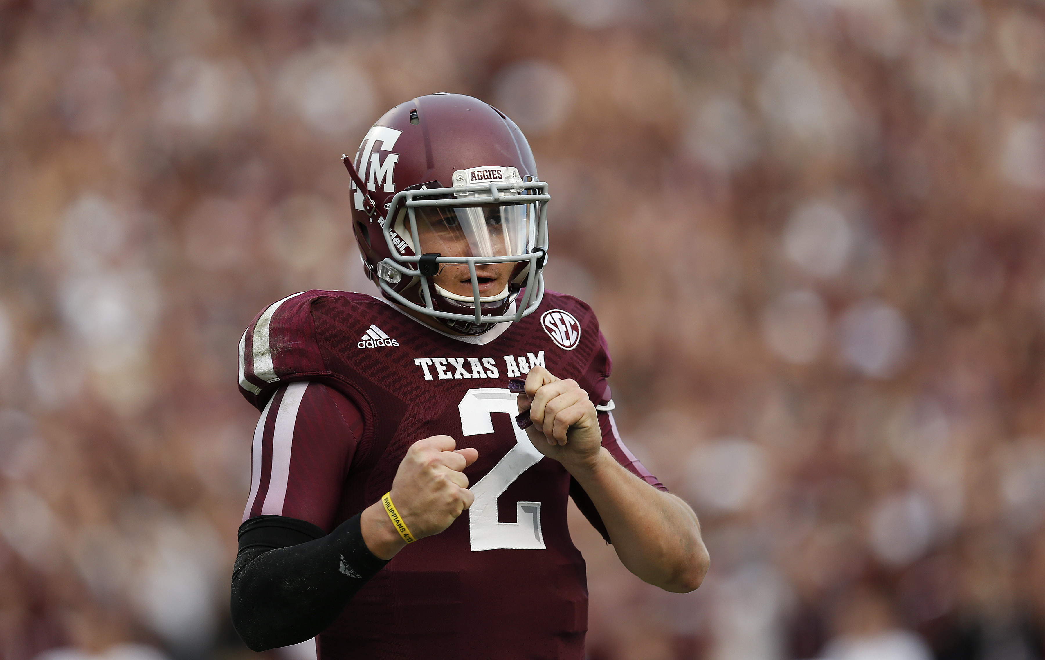 Texas A&M University Aggies quarterback Johnny Manziel (2) celebrates after throwing a touchdown pass during an NCAA college football game against the Mississippi State University Bulldogs at Kyle Field on Saturday November 9, 2013 in College Station, Texas. (AP Photo/Aaron M. Sprecher)