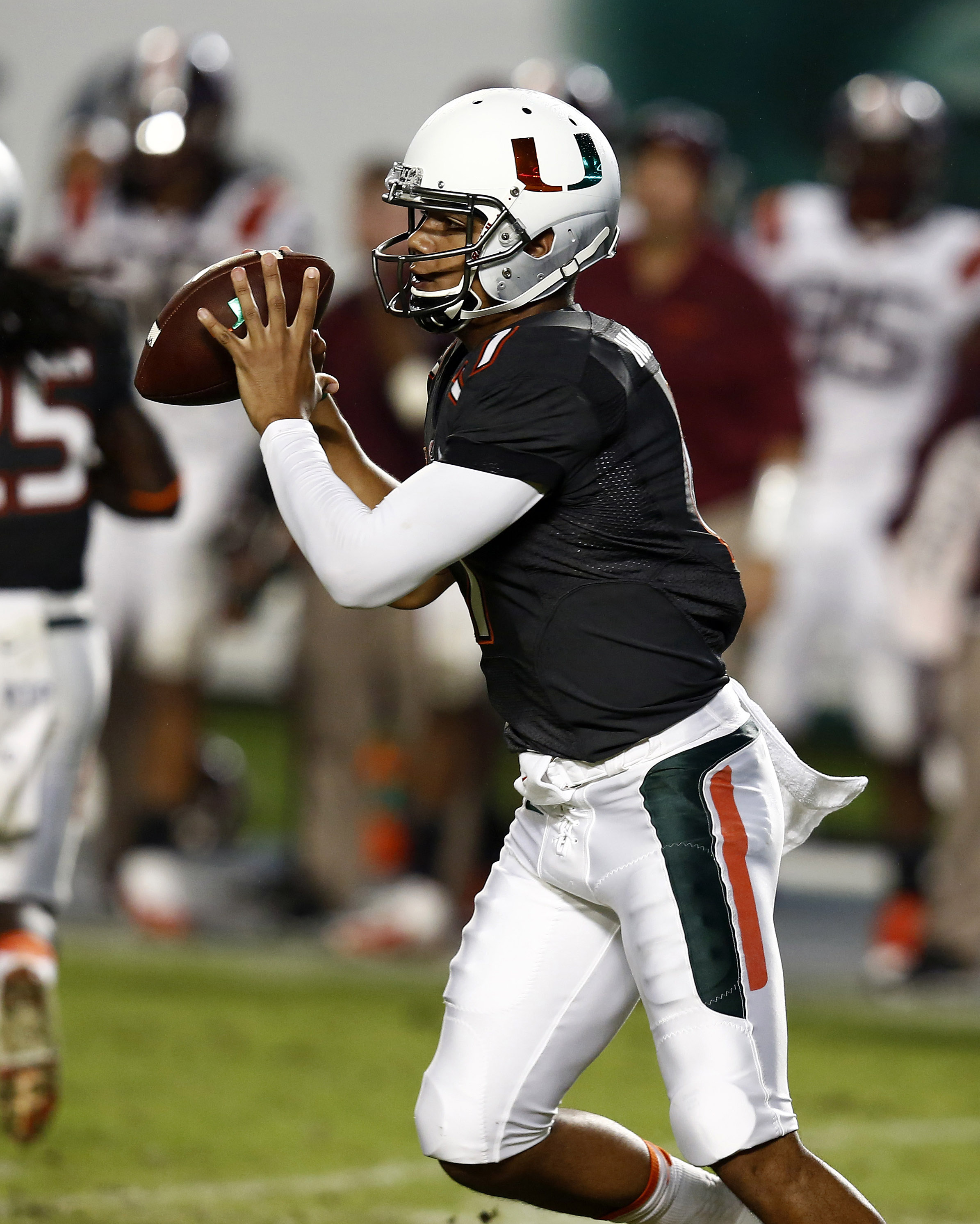 Nov 9, 2013; Miami Gardens, FL, USA;  Miami Hurricanes quarterback Stephen Morris (17) drops back to pass in the second quarter of a game against the Virginia Tech Hokies at Sun Life Stadium. Mandatory Credit: Robert Mayer-USA TODAY Sports