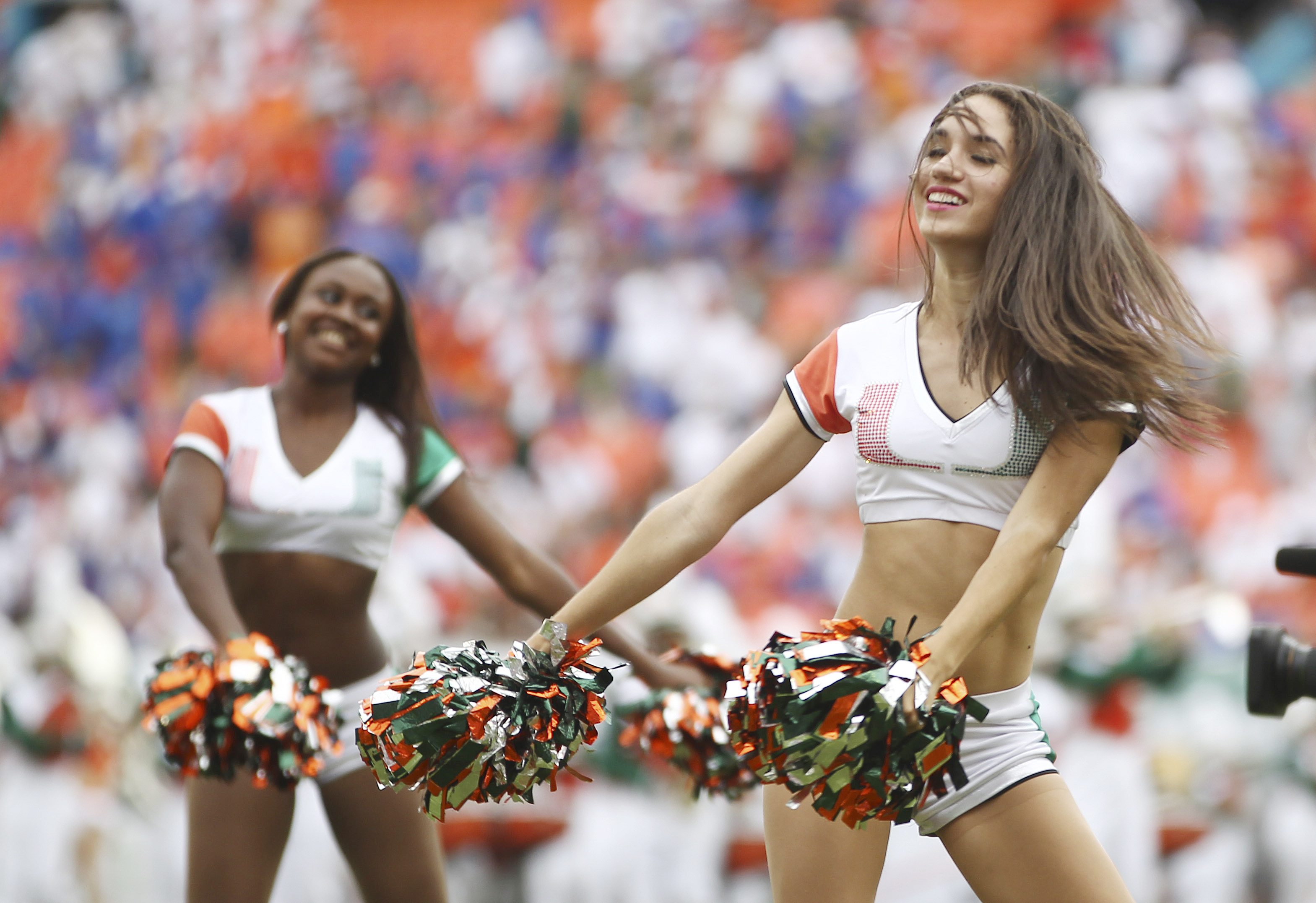 Miami cheerleaders dance during the second of a NCAA college football game in Miami Gardens, Fla., Saturday, Sept. 7, 2013. (AP Photo/J Pat Carter)