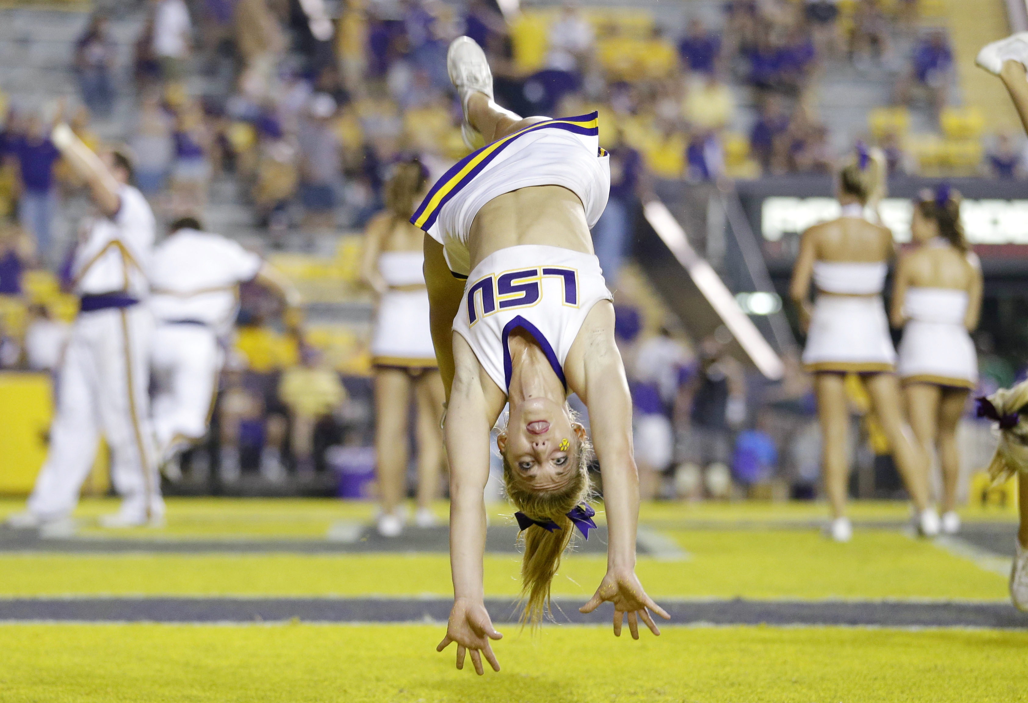 LSU cheerleaders perform in the second half of an NCAA college football game against Kent State in Baton Rouge, La., Saturday, Sept. 14, 2013. LSU won 45-13. (AP Photo/Gerald Herbert)