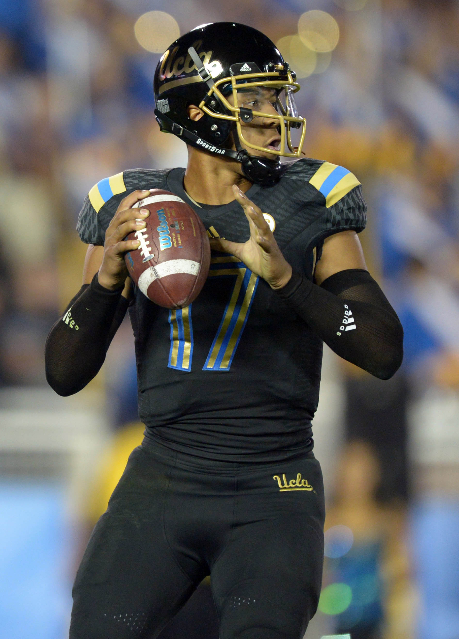 Nov 15, 2013; Pasadena, CA, USA; UCLA Bruins quarterback Brett Hundley (17) throws a pass against the Washington Huskies at Rose Bowl. Mandatory Credit: Kirby Lee-USA TODAY Sports