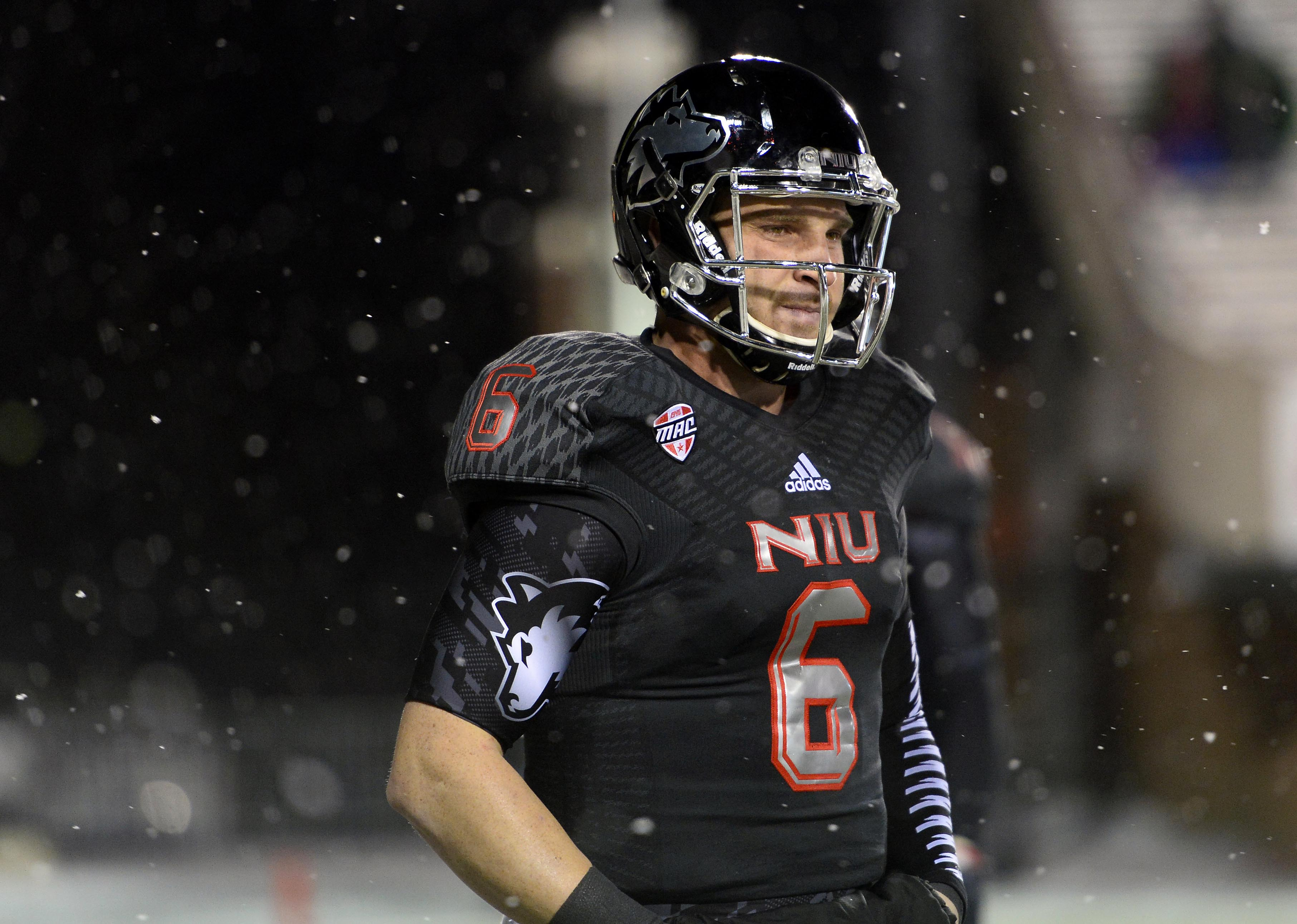 Nov 26, 2013; DeKalb, IL, USA; Northern Illinois Huskies quarterback Jordan Lynch (6) practices before the game against the Western Michigan Broncos at Huskie Stadium. (Mike DiNovo/USA TODAY Sports)