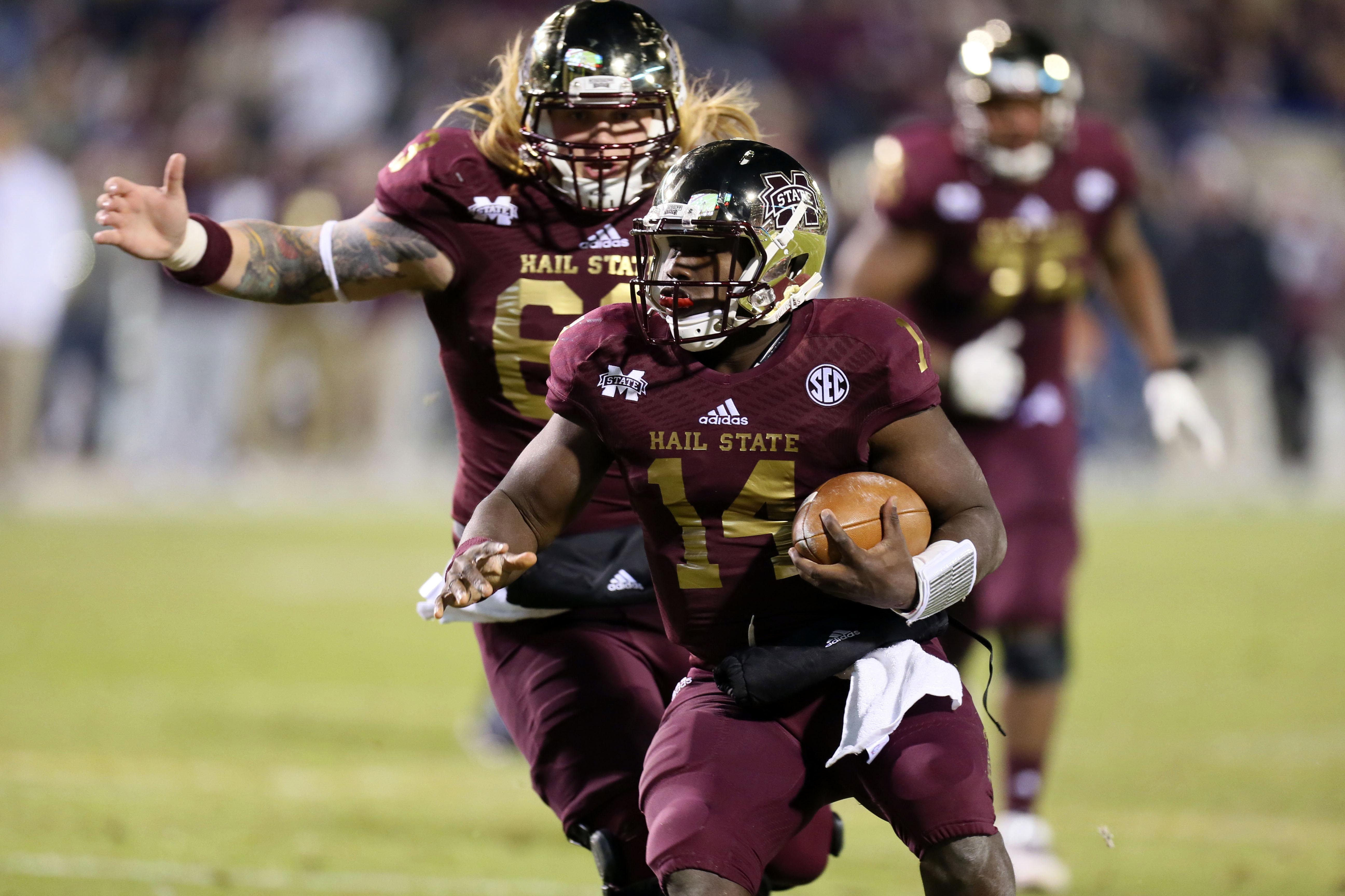 Mississippi State Bulldogs quarterback Damian Williams (14) runs with the ball during the game against the Mississippi Rebels at Davis Wade Stadium. (Spruce Derden/USA TODAY Sports)
