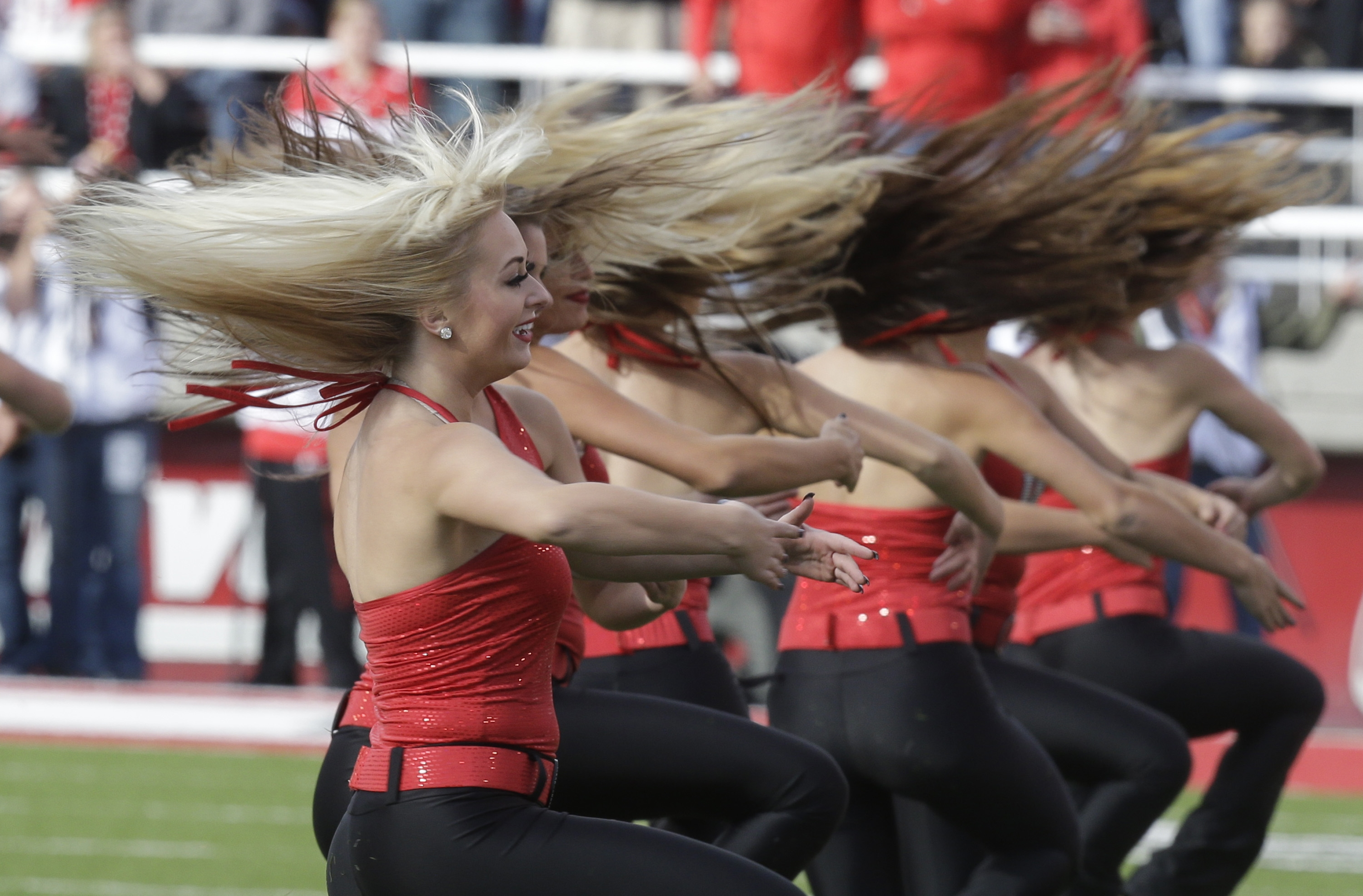 Utah cheerleading dance team perform before the start of their NCAA college football game against Stanford Saturday, Oct. 12, 2013, in Salt Lake City. (AP Photo/Rick Bowmer)