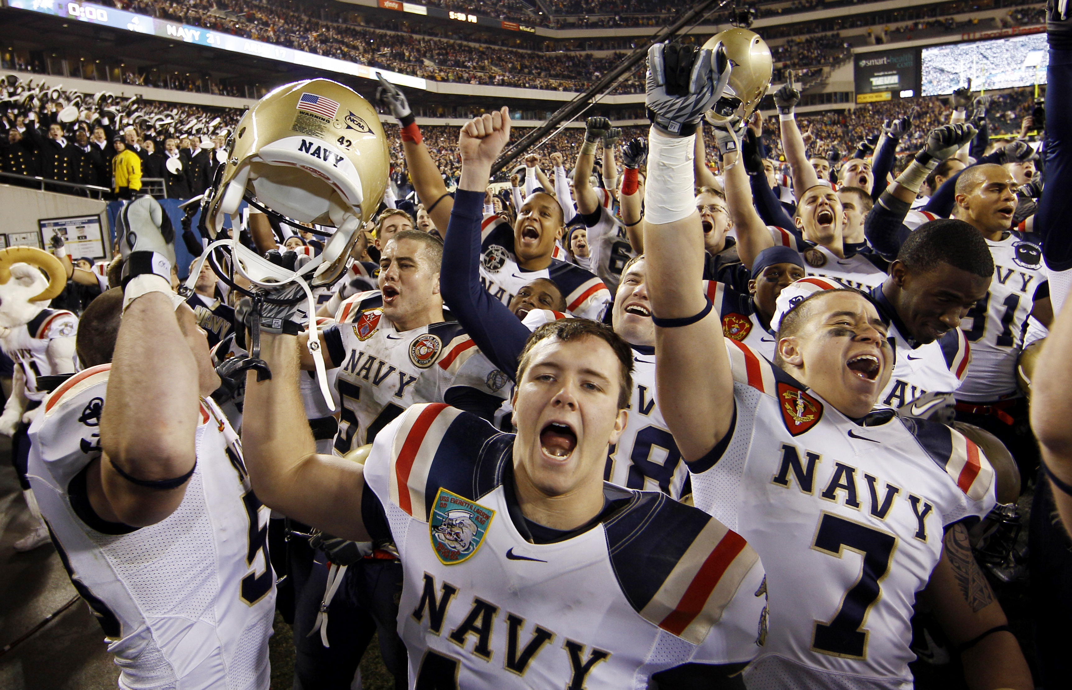 Navy's Mason Graham, center, celebrates with teammates after an NCAA college football game against Army, Saturday, Dec. 11, 2010, in Philadelphia. Navy won 31-17. (AP Photo/Matt Slocum)