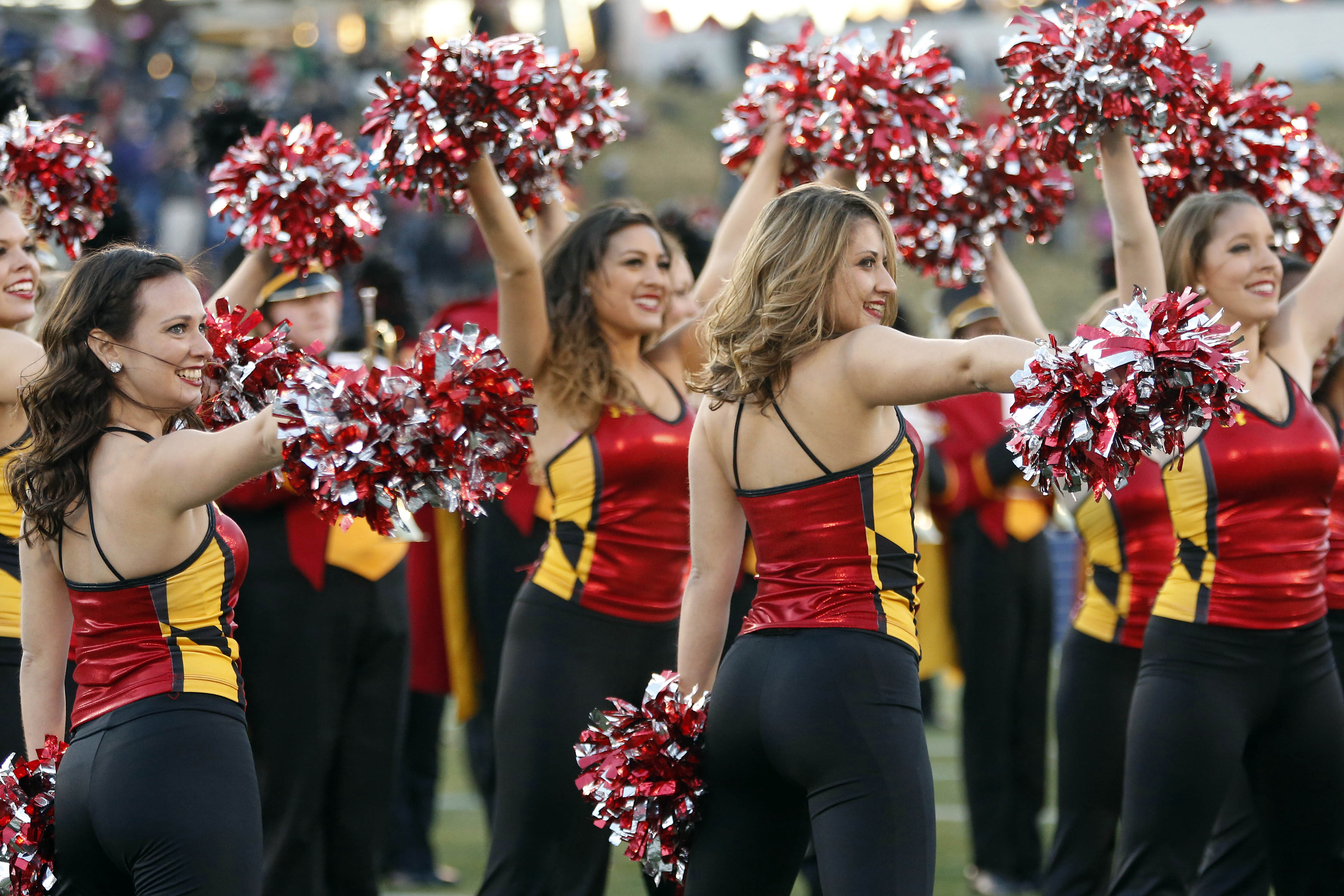 The Maryland Terrapins cheerleaders dance on the field during a stoppage in play against the Marshall Thundering Herd during the 2013 Military Bowl at Navy Marine Corps Memorial Stadium. (Geoff Burke/USA TODAY Sports)