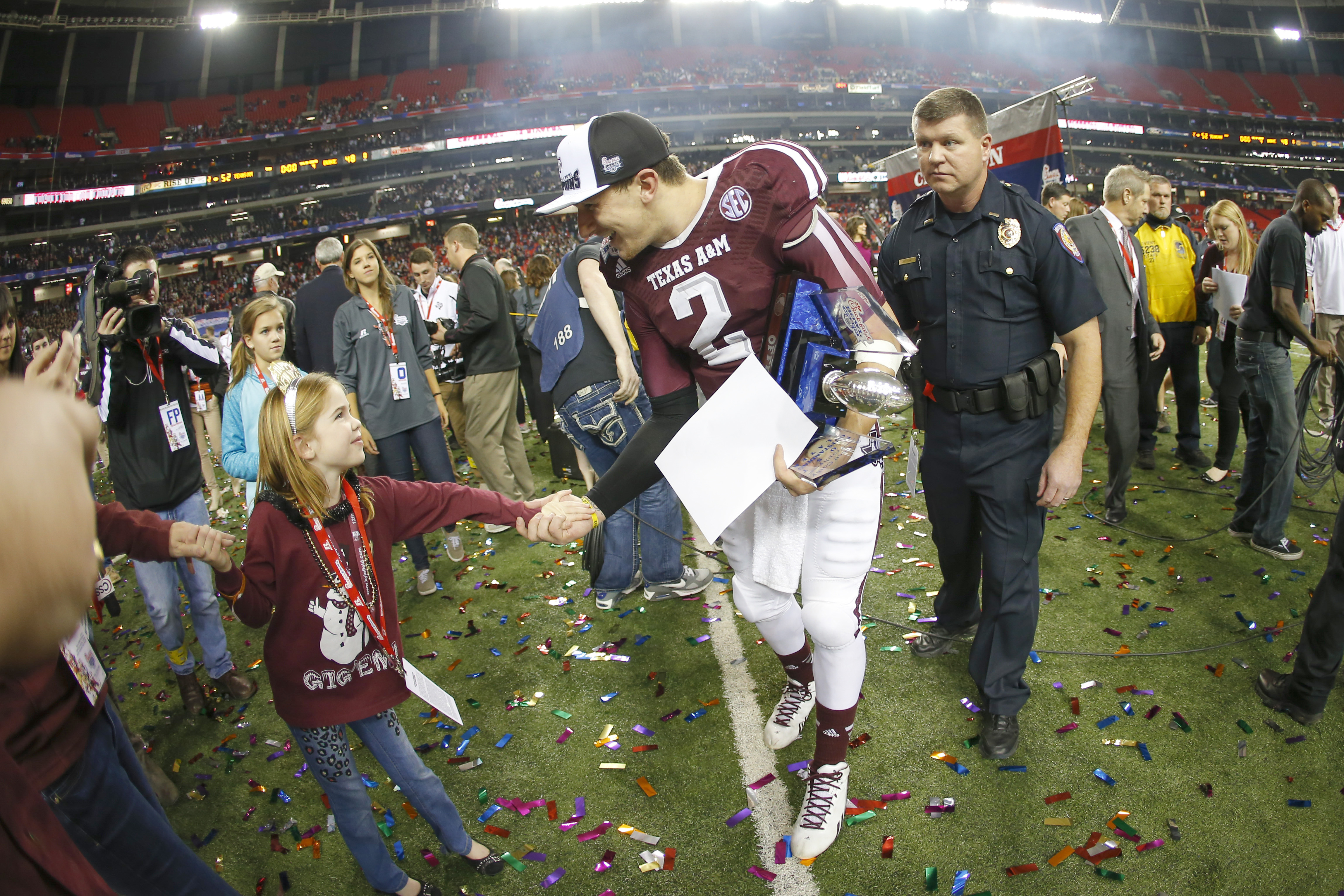 Texas A&M Aggies quarterback Johnny Manziel (2) greets a young fan after defeating the Duke Blue Devils during the 2013 Chick-fil-A Bowl at the Georgia Dome. Texas A&M won 52-48. (Paul Abell-USA TODAY Sports)