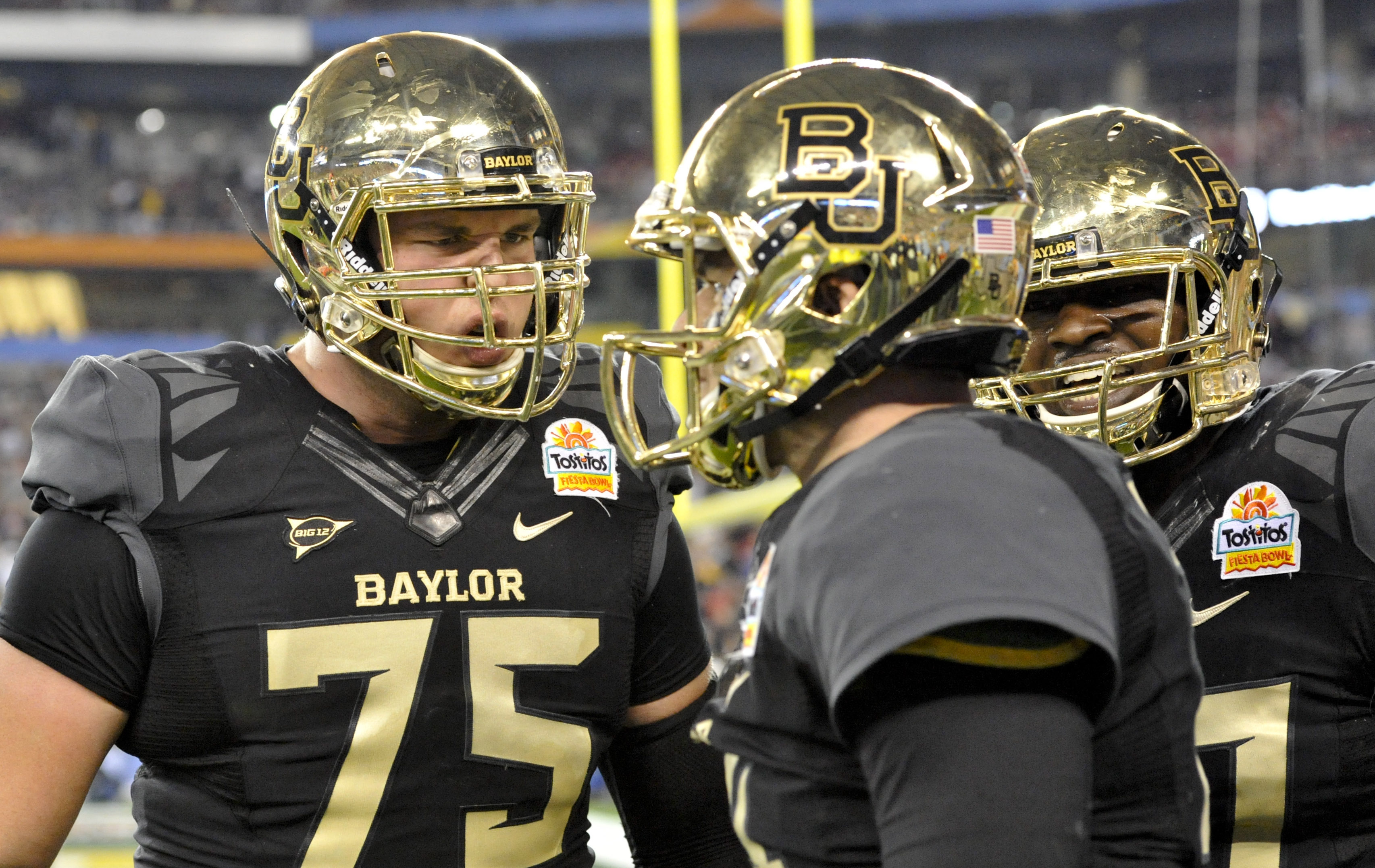 Baylor Bears offensive lineman Troy Baker (75) and offensive lineman Kelvin Palmer (77) congratulate quarterback Bryce Petty (14) after a touchdown during the second quarter against the UCF Knights at University of Phoenix Stadium during the Fiesta Bowl on Jan. 1, 2014 in Glendale, AZ. (Casey Sapio/USA TODAY Sports)
