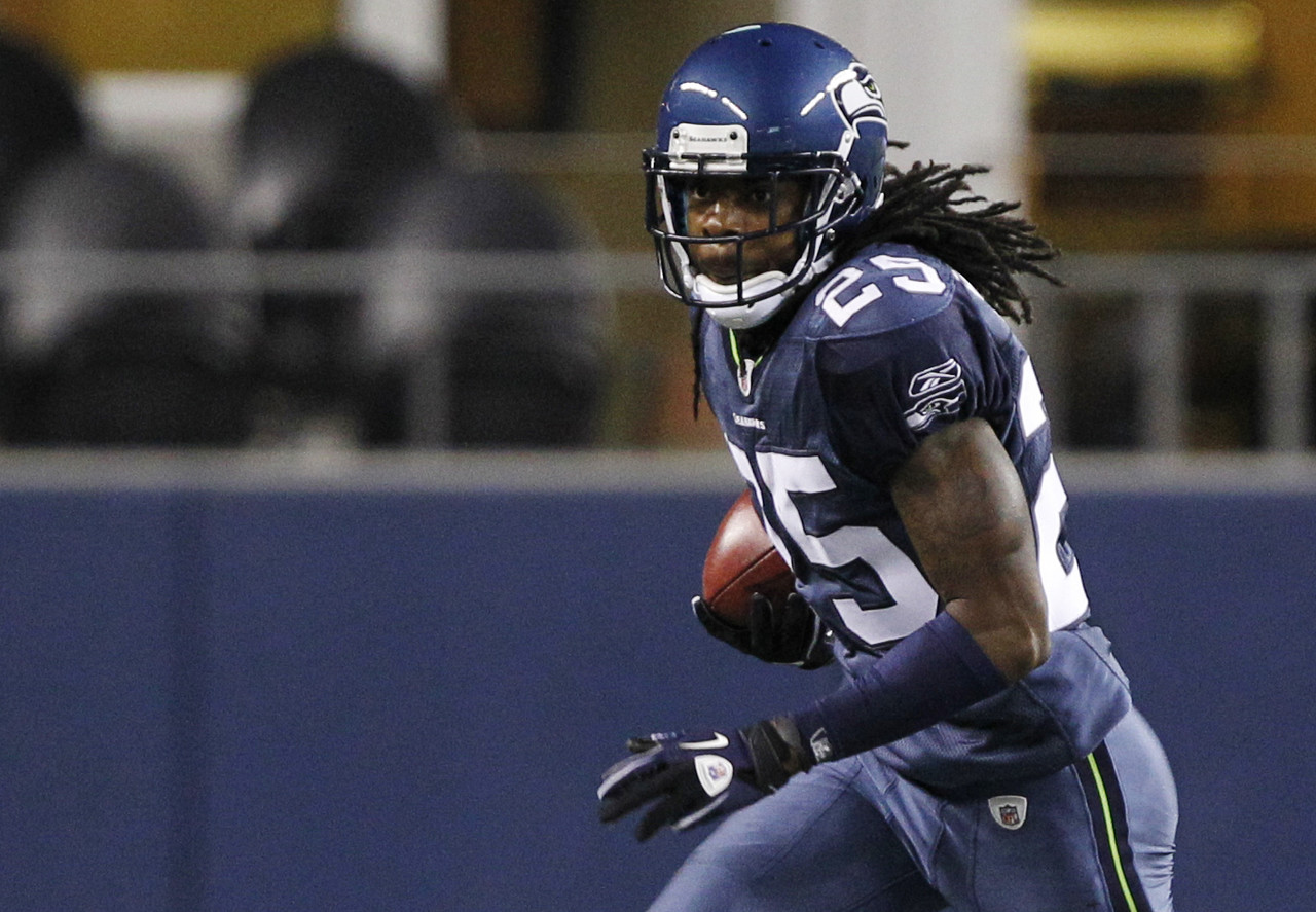 Seattle Seahawks' Richard Sherman carries the ball in the second half of a preseason NFL football game against the Oakland Raiders in Seattle on Sept. 2, 2011.