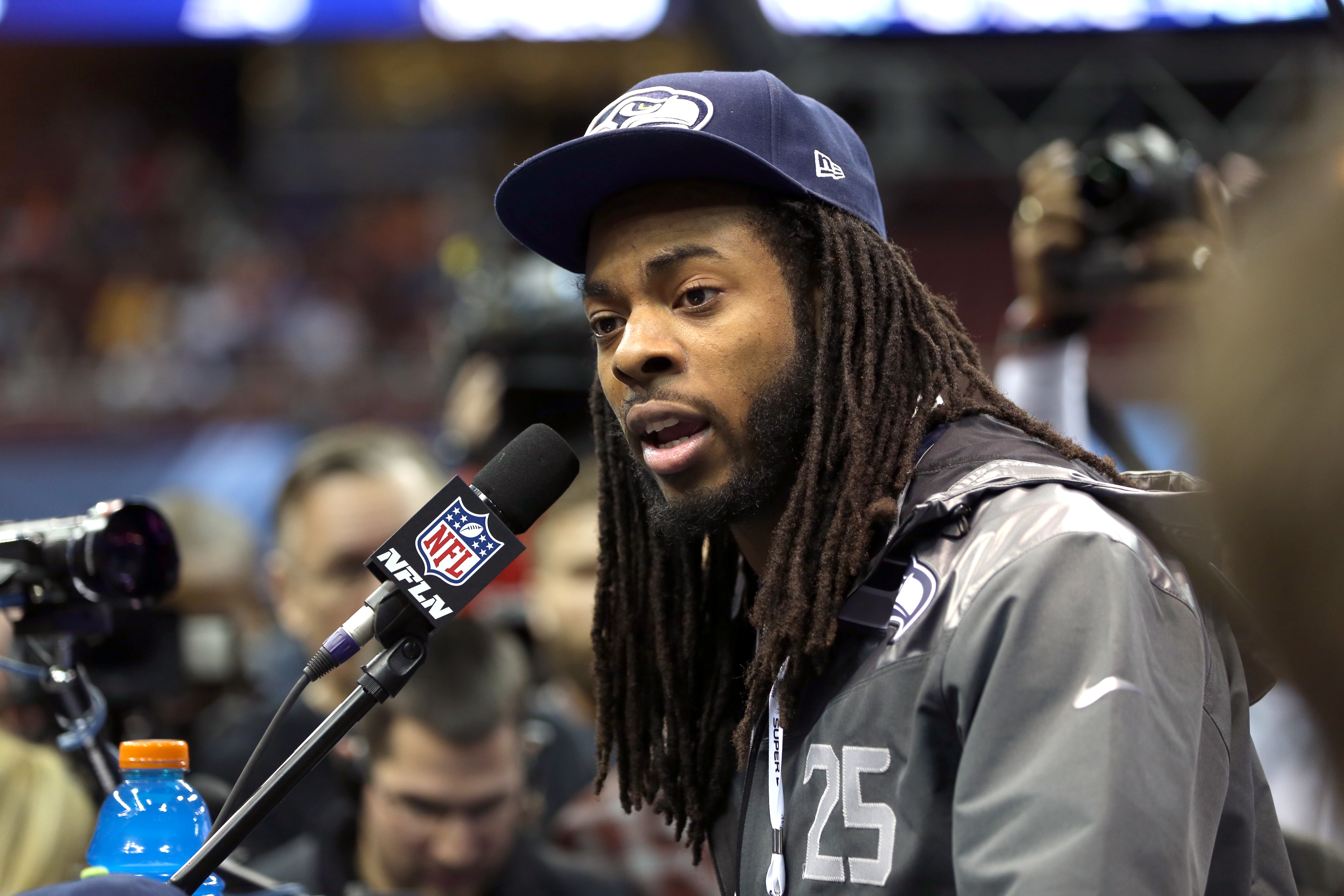 Seattle Seahawks cornerback Richard Sherman (25) answers questions from the media during the Super Bowl XLVIII Media Day at the Prudential Center on Tuesday, January 28, 2014 in Newark, NJ. (Ben Liebenberg/NFL)