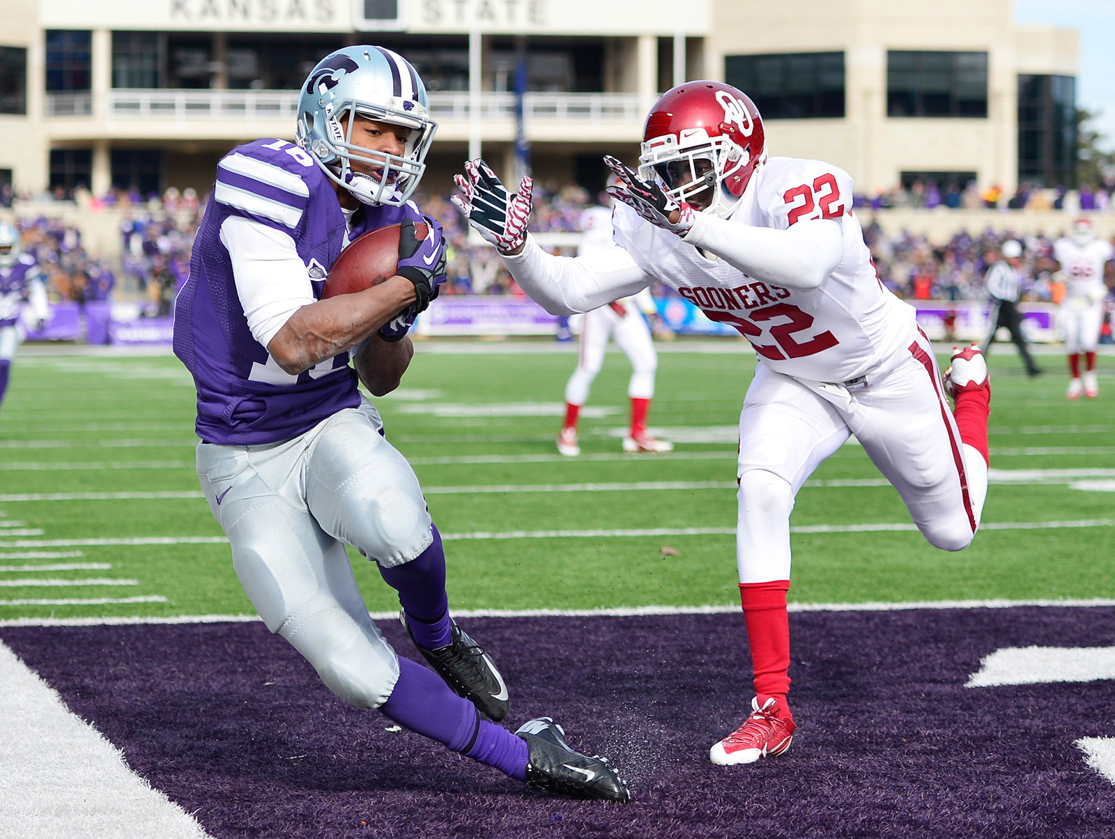 Kansas State Wildcats wide receiver Tyler Lockett (16) catches a pass for a touchdown while being defended by Oklahoma Sooners defensive back Cortez Johnson (22) during the first half at Bill Snyder Family Stadium. (Jasen Vinlove/USA TODAY Sports)