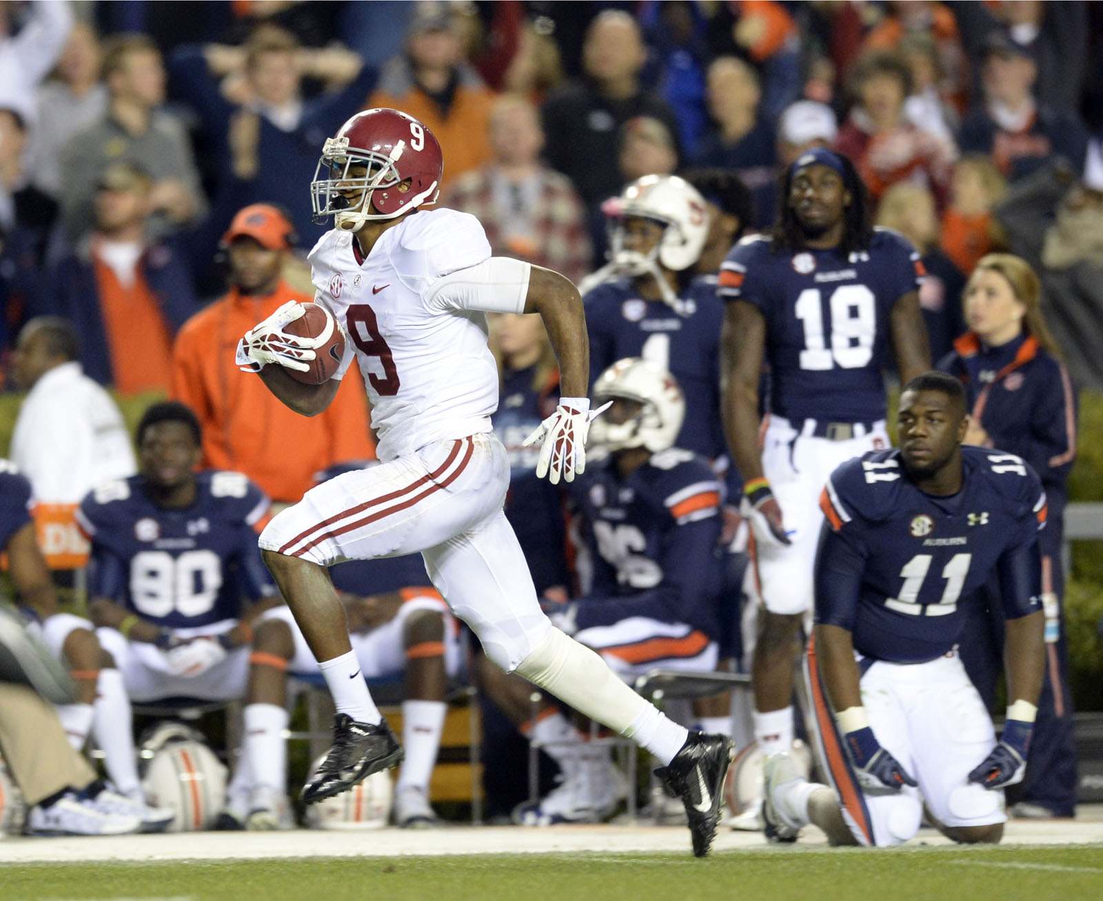 Alabama Crimson Tide wide receiver Amari Cooper (9) makes a catch and runs for a 99 yard touchdown against the Auburn Tigers during the fourth quarter at Jordan Hare Stadium. (John David Mercer/USA TODAY Sports)