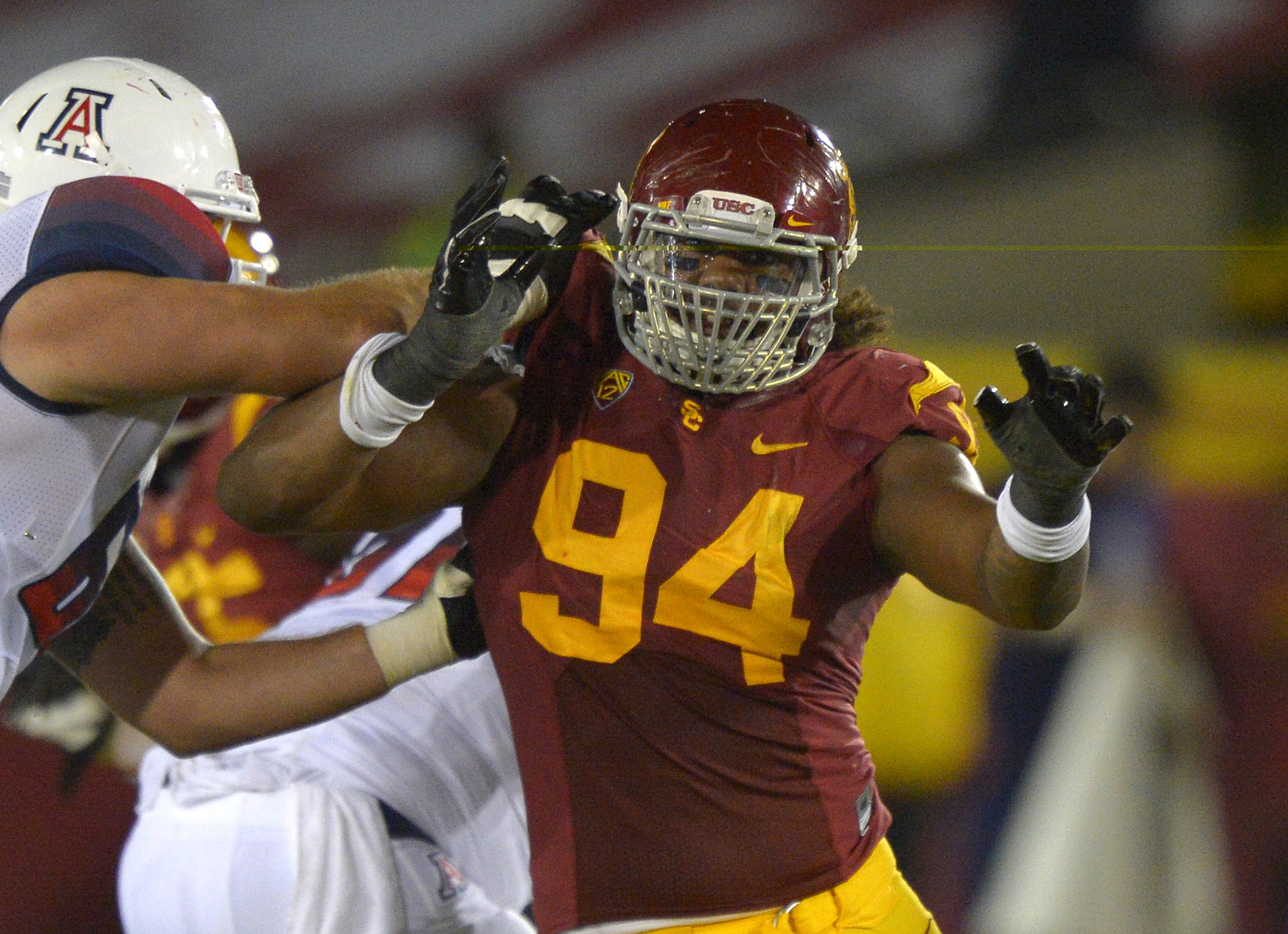 Southern California defensive end Leonard Williams, right, tries to get by Arizona safety RJ Morgan during the second half of their NCAA college football game, Thursday, Oct. 10, 2013, in Los Angeles. USC won 38-31. (Mark J. Terrill/Associated Press)