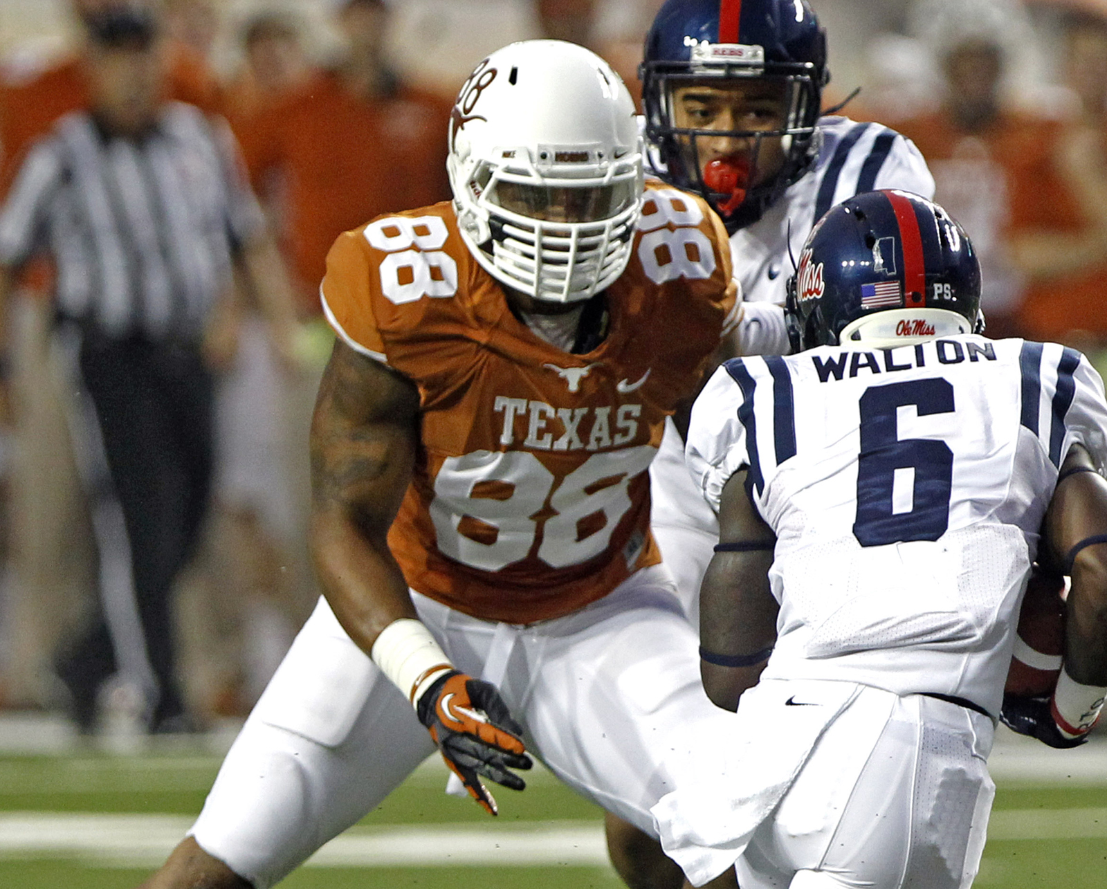 Texas defender Cedric Reed (88) defends against Mississippi running back Jaylen Walton (6) during the second quarter of an NCAA college football game Saturday, Sept. 14, 2013, in Austin, Texas. (Michael Thomas/Associated Press)