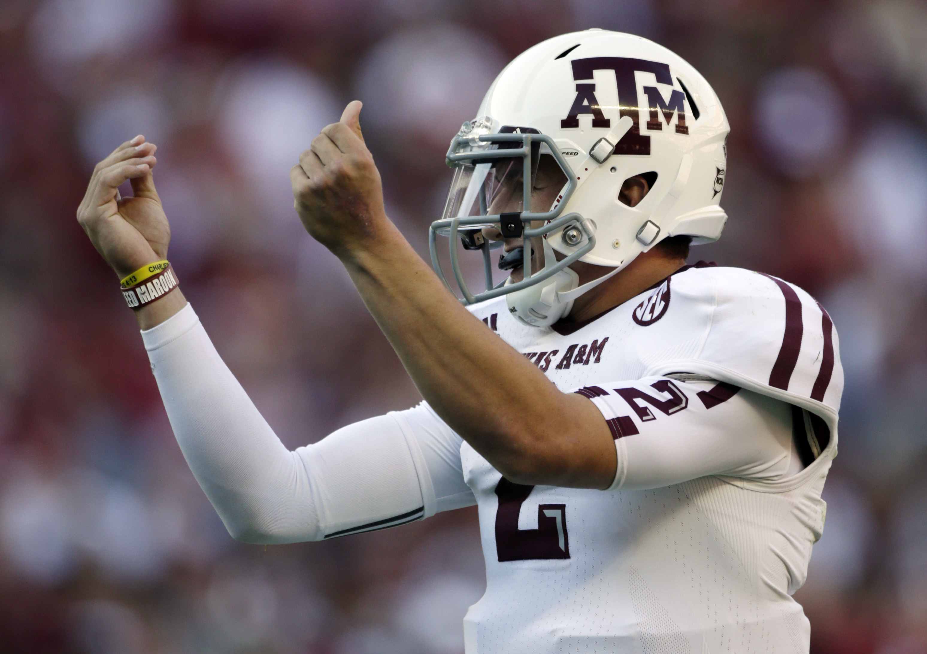 Texas A&M quarterback Johnny Manziel (2) reacts after the Aggies scored their third touchdown of the first quarter against Alabama during the first half of an NCAA college football game at Bryant-Denny Stadium in Tuscaloosa, Ala., Saturday, Nov. 10, 2012. (AP Photo/Dave Martin)