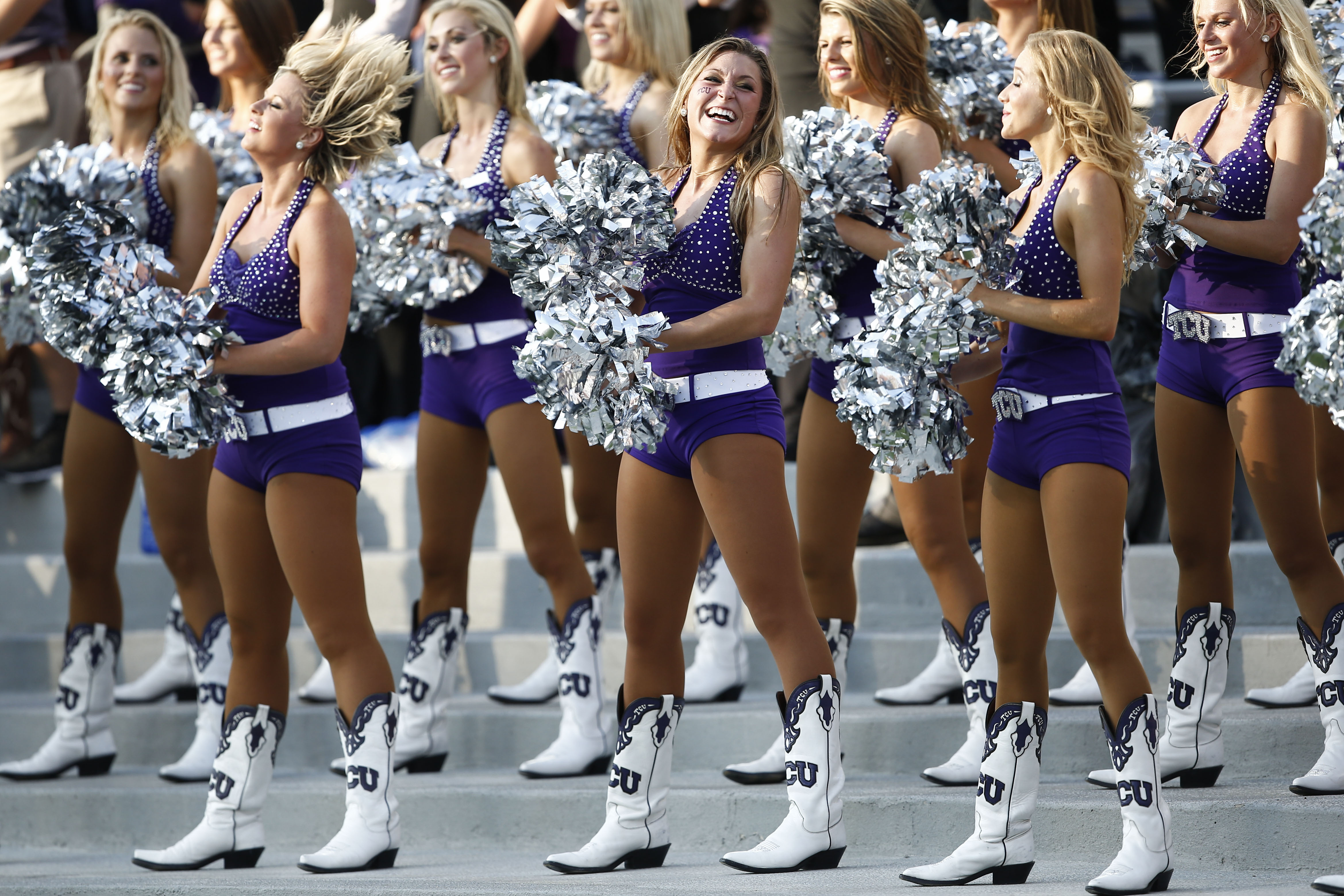 TCU showgirls perform in the first half of an NCAA college football game against Samford in Fort Worth, Texas, Saturday, Aug. 30, 2014. (AP Photo/Jim Cowsert)