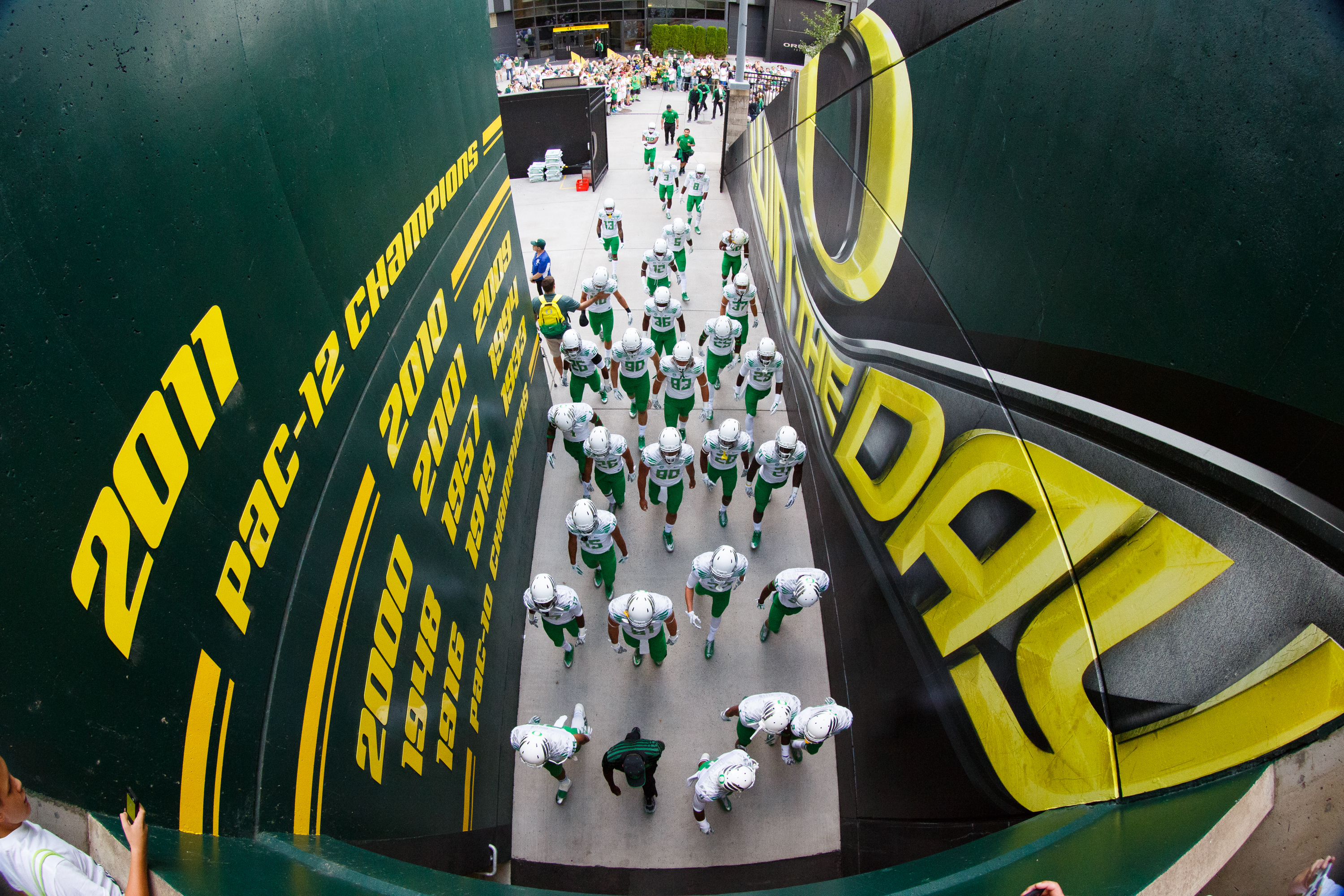 The Oregon football team walks through a tunnel before an NCAA college football game against South Dakota in Eugene, Ore., Saturday, Aug. 30, 2014. (AP Photo/Ryan Kang)
