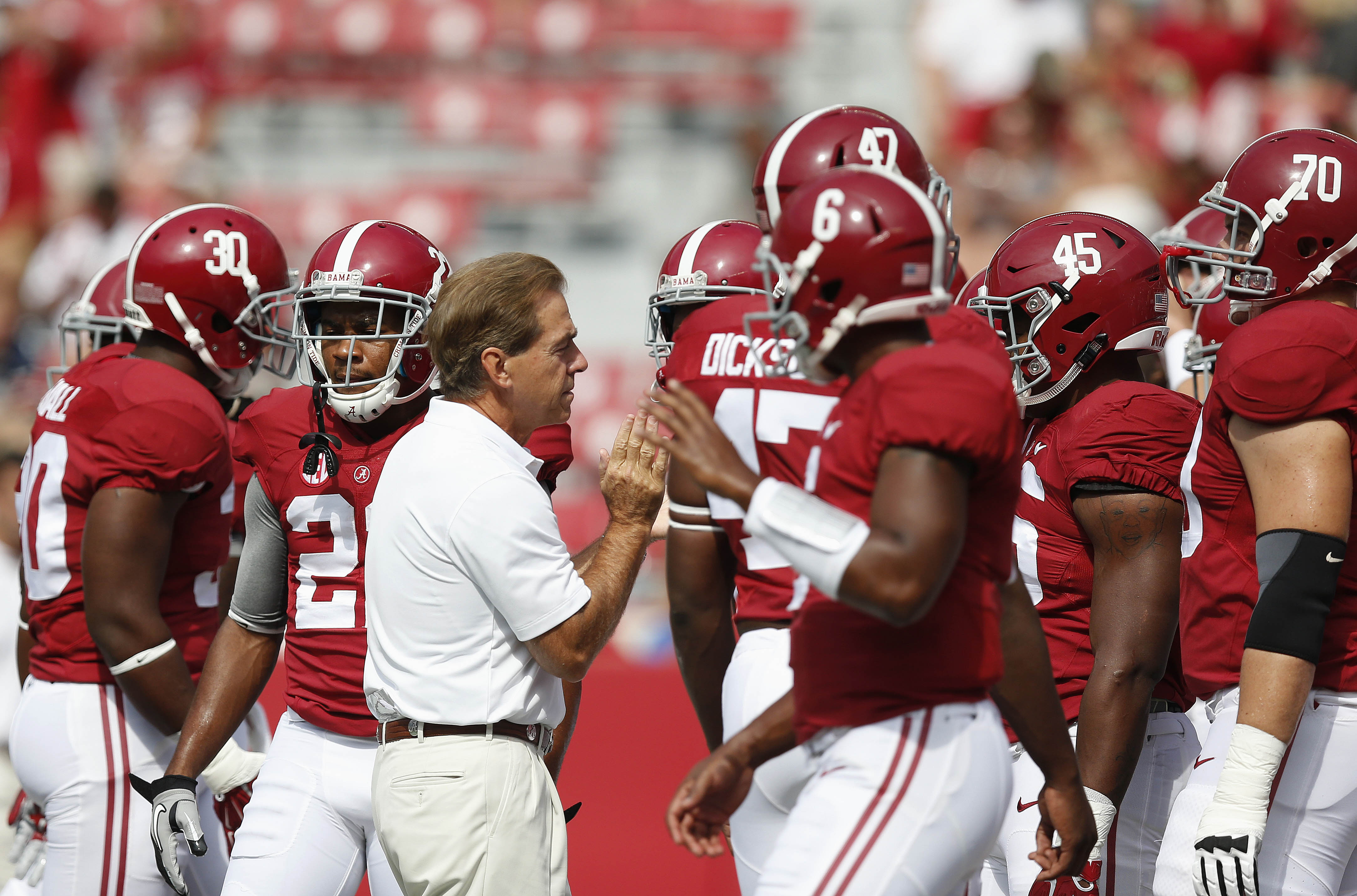 Head coach Nick Saban prepares the team for before the first half of an NCAA college football game against Florida Atlantic Saturday, Sept. 6, 2014, in Tuscaloosa, Ala. (AP Photo/Brynn Anderson)