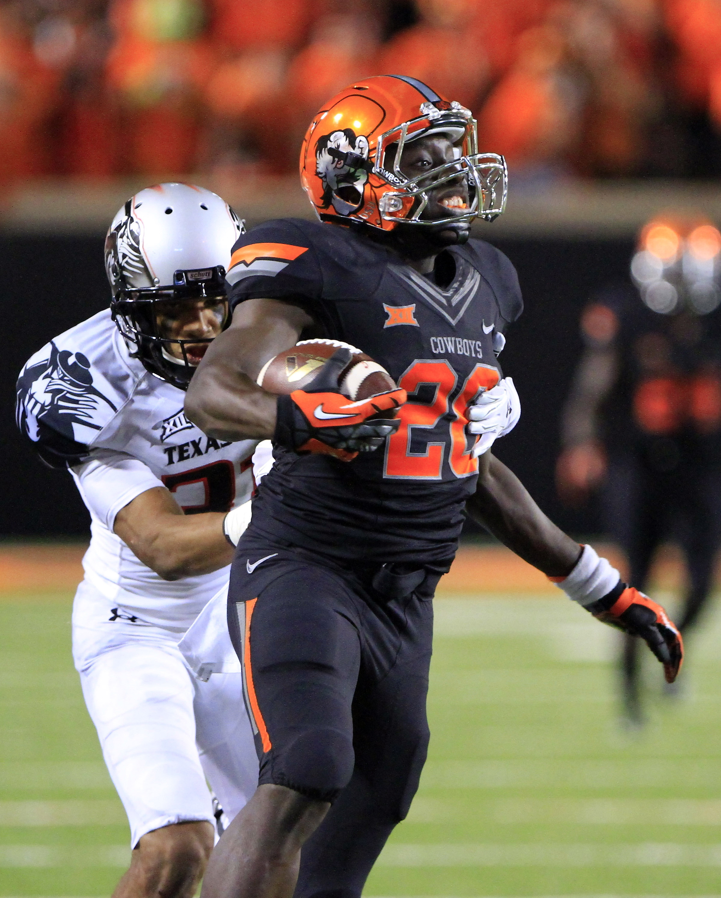 Texas Tech Red Raiders defensive back Justis Nelson (31) tackles Oklahoma State Cowboys running back Corey Bennett (20) during the second half of a game at Boone Pickens Stadium. Oklahoma State won 45-35. (Alonzo Adams-USA TODAY Sports)