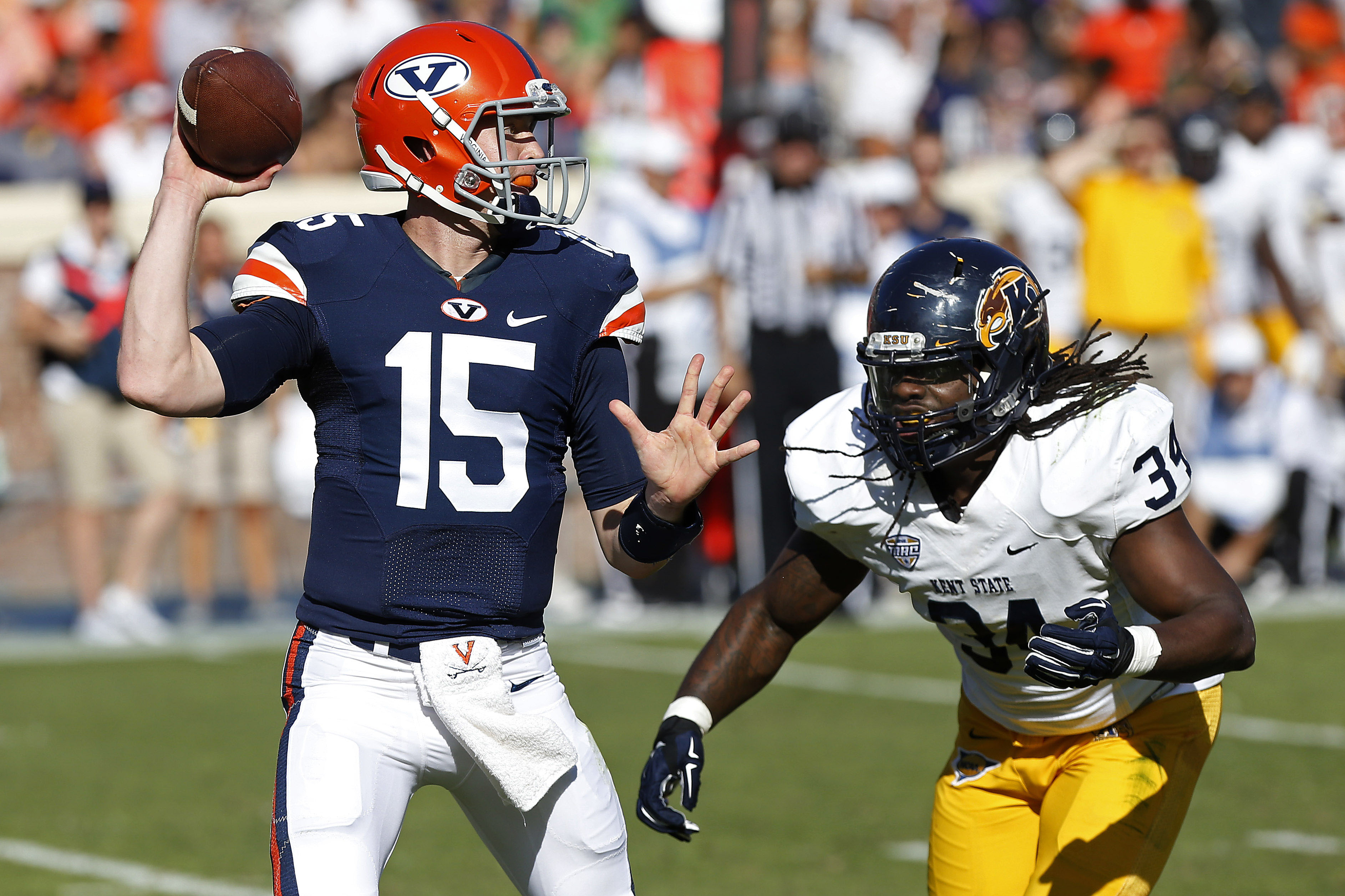 Virginia Cavaliers quarterback Matt Johns (15) throws the ball as Kent State Golden Flashes defensive lineman Richard Gray (34) chases in the first quarter at Scott Stadium. (Geoff Burke-USA TODAY Sports)