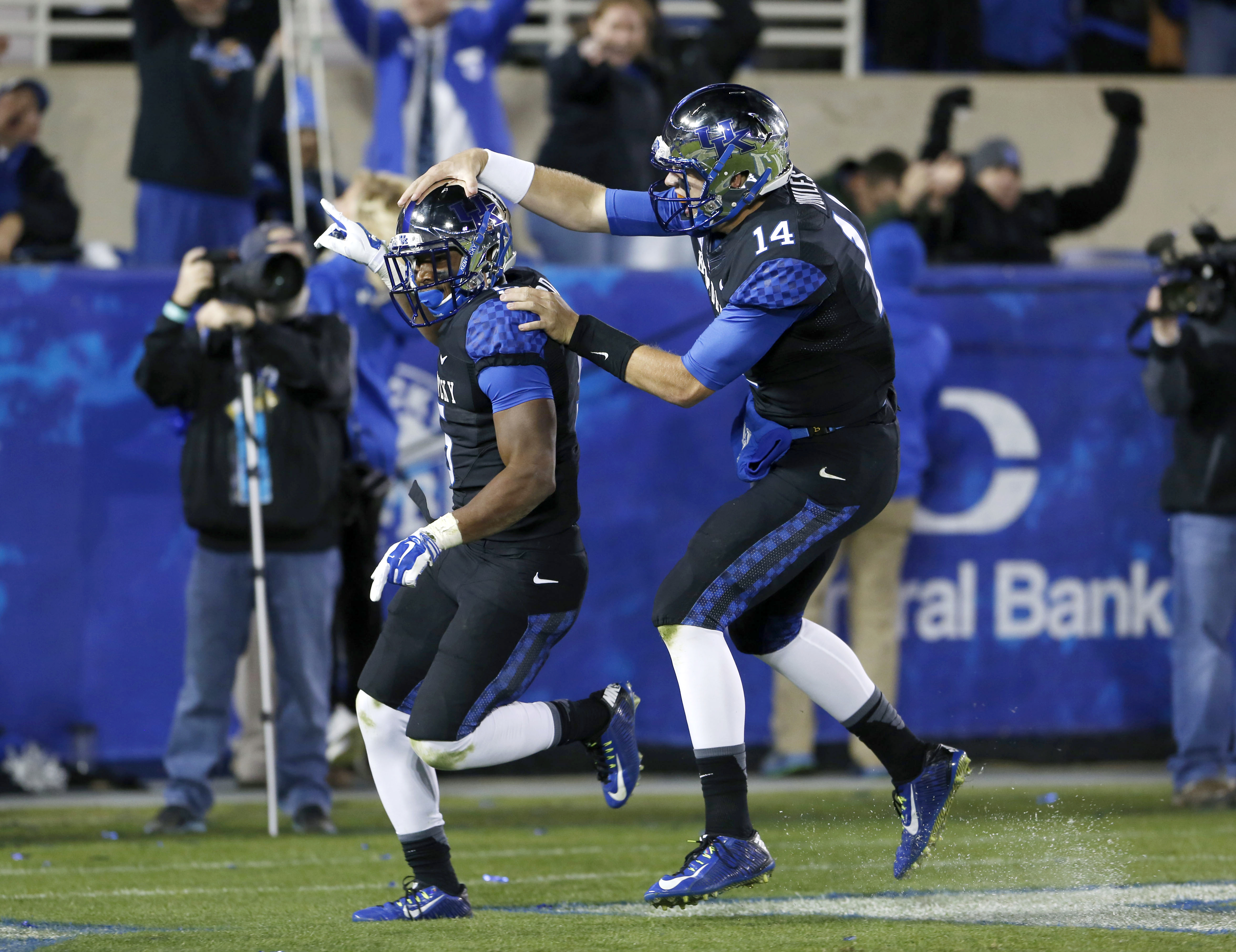 Kentucky Wildcats running back Braylon Heard (5) celebrates with quarterback Patrick Towles (14) during the game against the South Carolina Gamecocks in the first half at Commonwealth Stadium. (Mark Zerof-USA TODAY Sports)