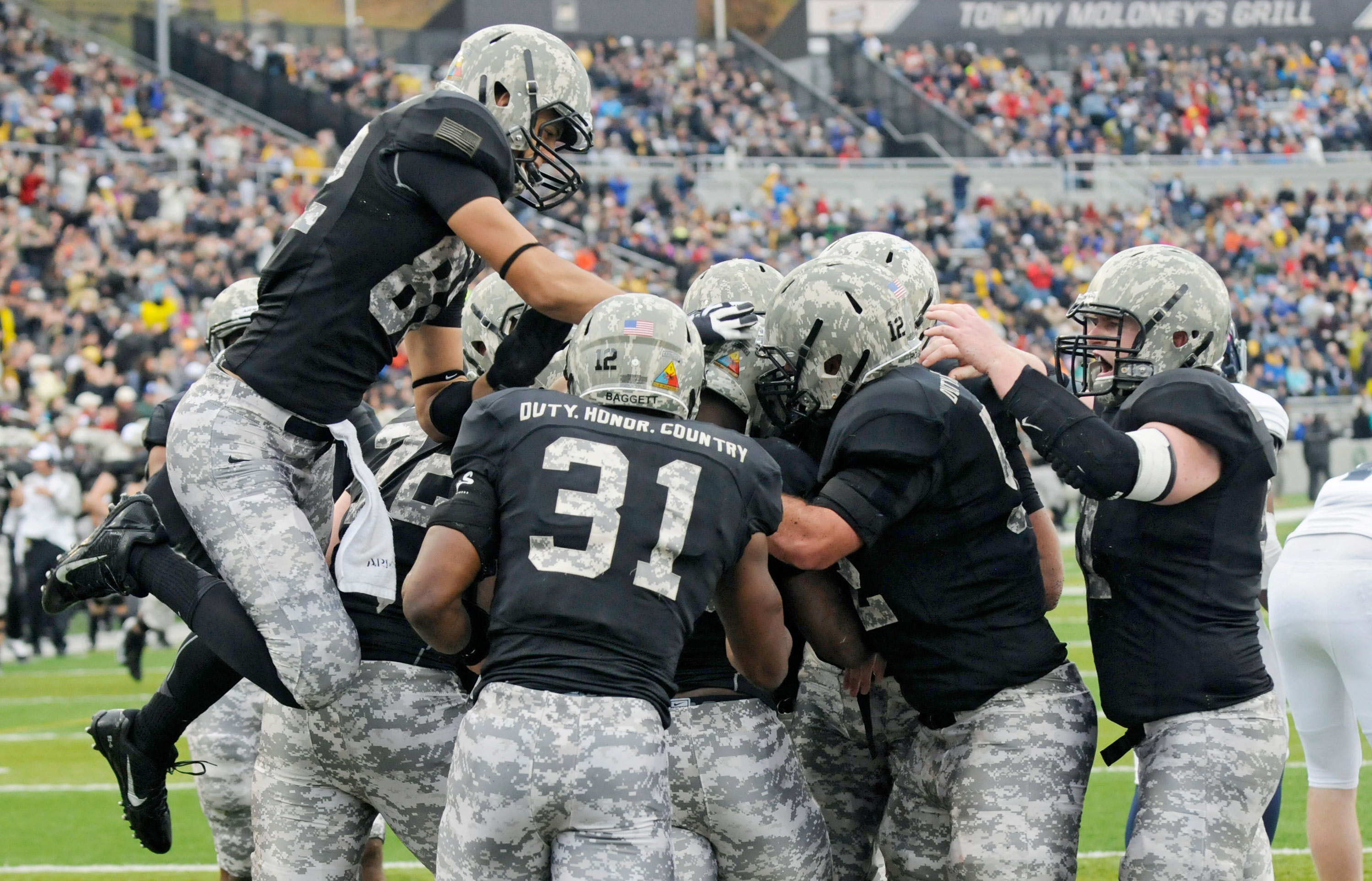 Army players celebrate a Larry Dixon touchdown against Rice during the first half of an NCAA college football game in West Point, N.Y. (AP Photo/Hans Pennink)