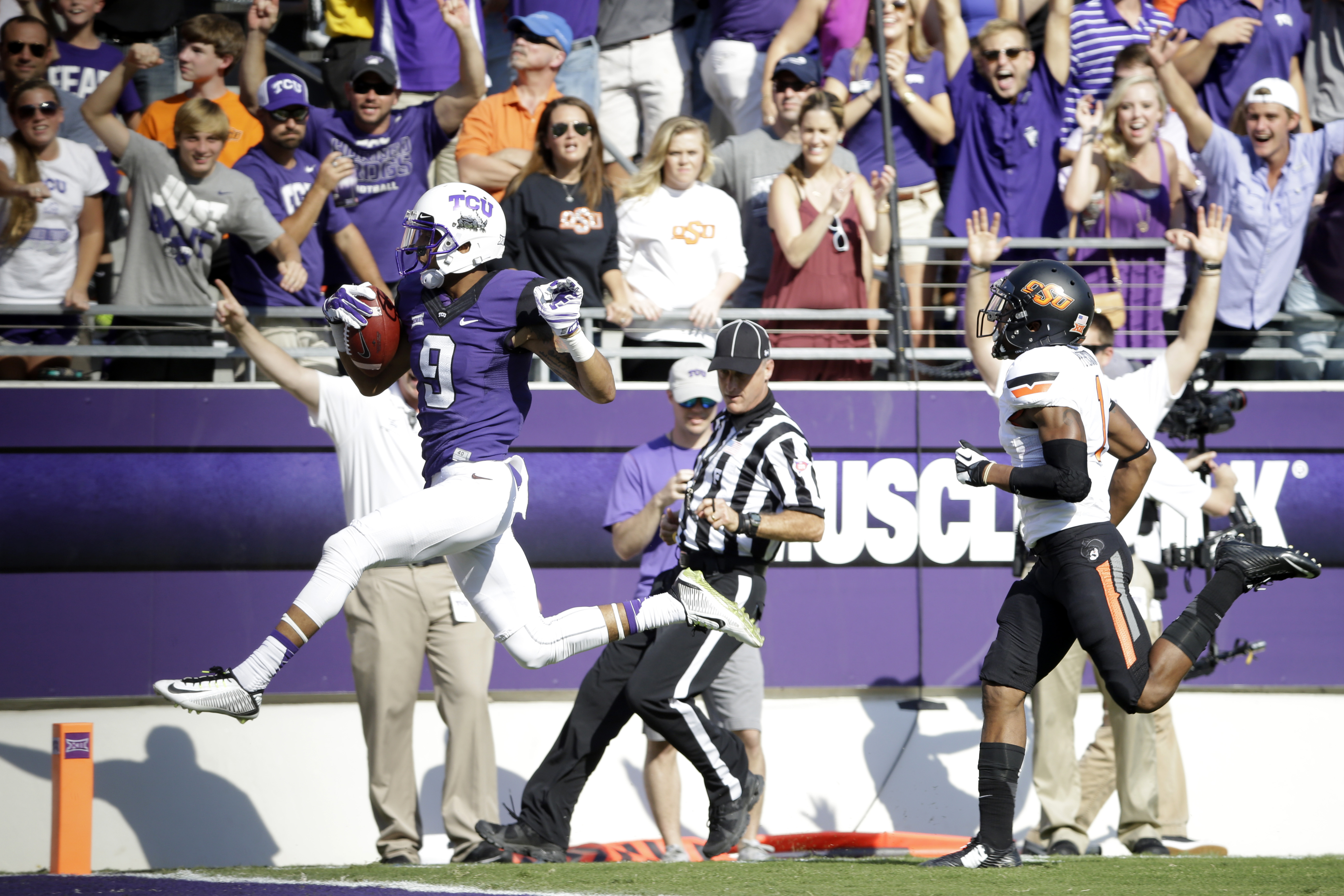 TCU's Josh Doctson (9) sprints into the end zone for a score ahead of Oklahoma State cornerback Kevin Peterson (1) during an NCAA college football game, Saturday, Oct. 18, 2014, in Fort Worth, Texas. (AP Photo/Tony Gutierrez)