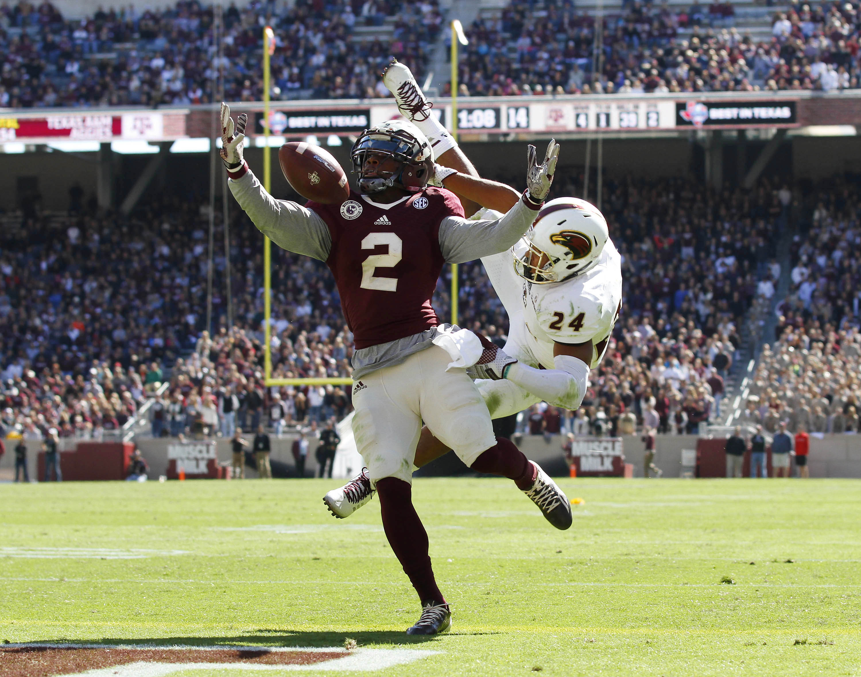 Nov 1, 2014; College Station, TX, USA; Texas A&M Aggies wide receiver Speedy Noil (2) makes the 39-yard touchdown catch as Louisiana Monroe Warhawks cornerback Trey Caldwell (24) defends on the play during the second quarter at Kyle Field. (Ray Carlin-USA TODAY Sports)