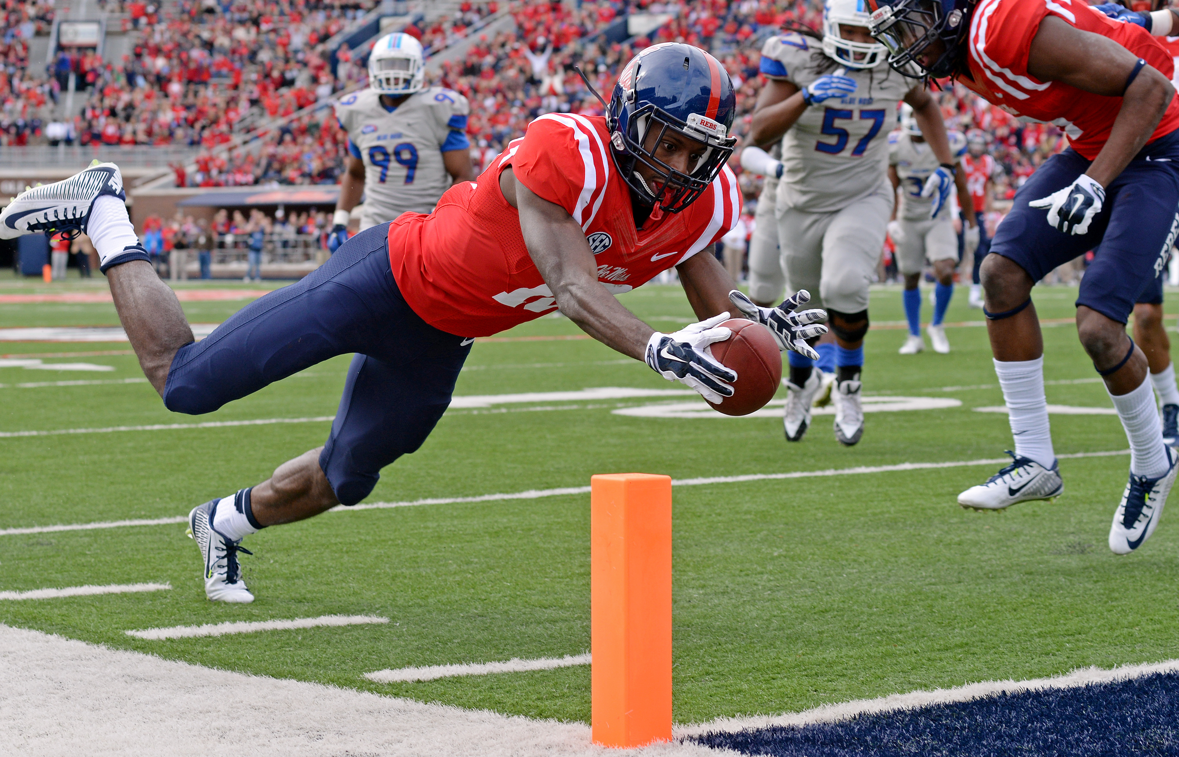Mississippi wide receiver Vince Sanders (10) dives in to the end zone for a touchdown during the first half of an NCAA college football game against Presbyterian in Oxford, Miss., Saturday, Nov. 8, 2014. (AP Photo/Thomas Graning)