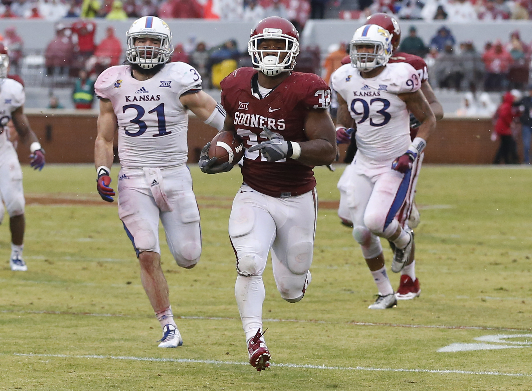 On Nov. 22, 2014, Perine broke Melvin Gordon's week-old record in a 44-7 win over Kansas in rainy Norman, Okla. Perine had five touchdown runs in the win. (AP Photo/Sue Ogrocki)