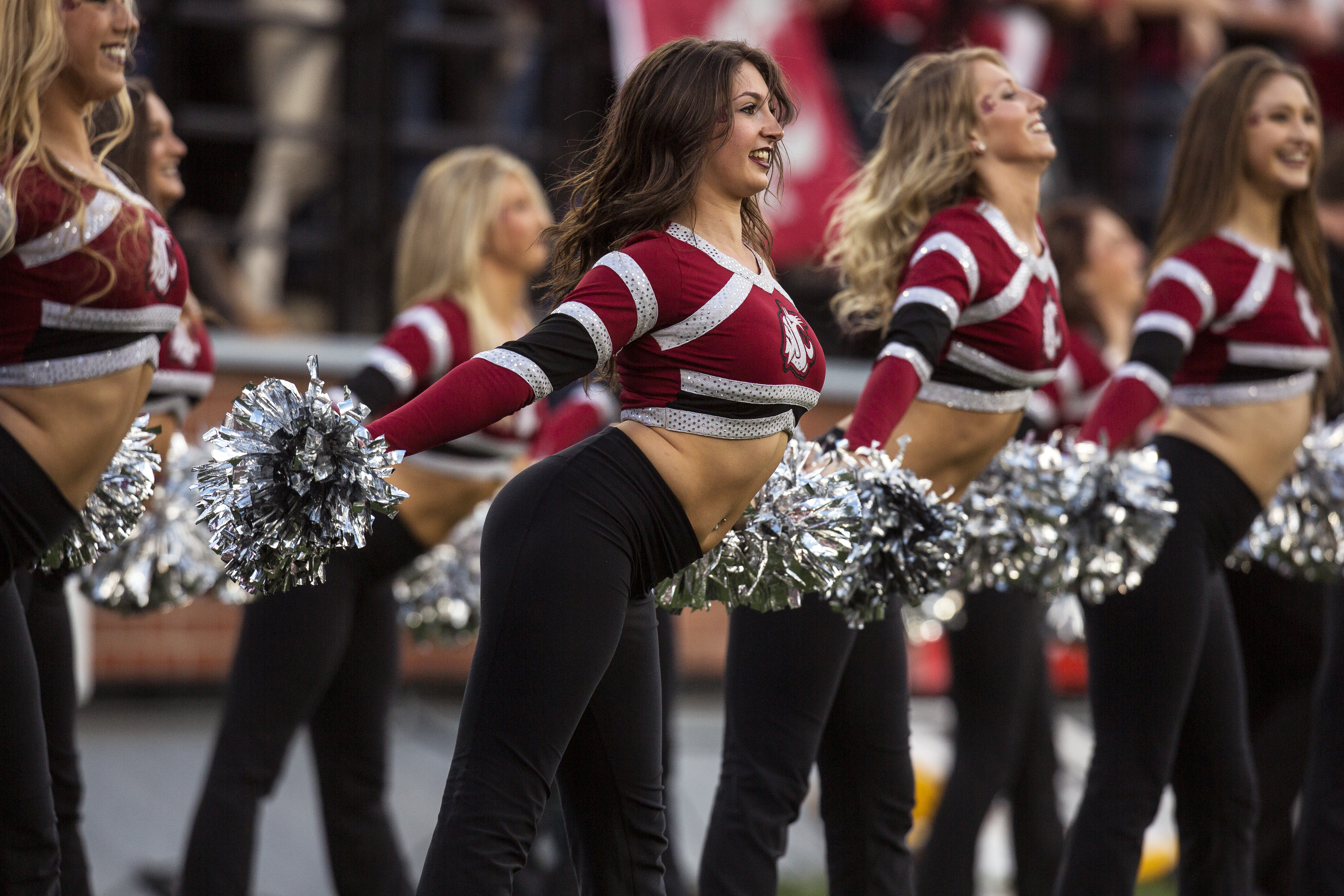 Members of the Washington State Crimson Girls dance team perform during a second quarter timeout in an NCAA college football game against Arizona on Saturday, Oct. 25, 2014, at Martin Stadium in Pullman, Wash. Arizona won 59-37. (AP Photo/Dean Hare)