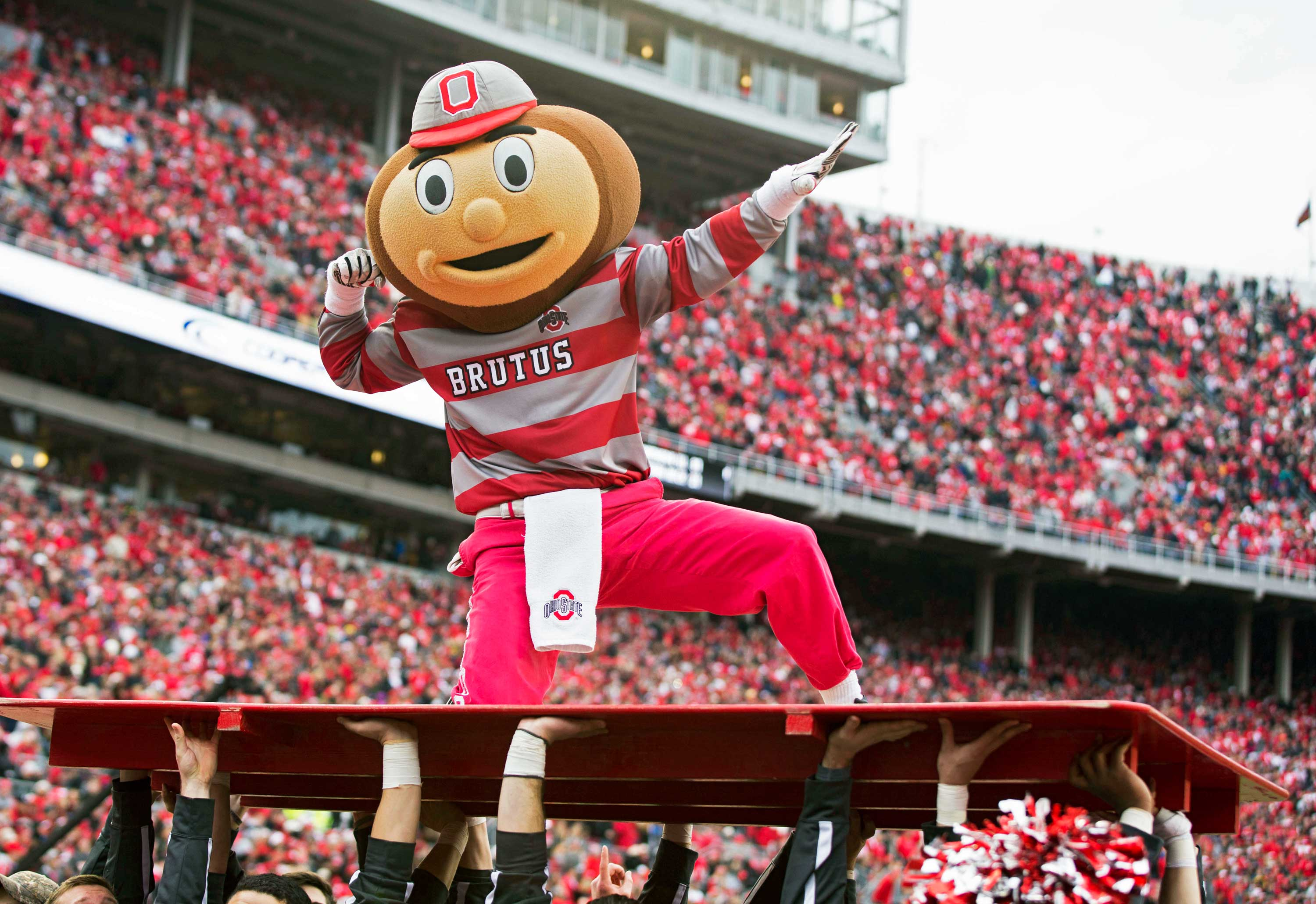 Nov 29, 2014; Columbus, OH, USA; Ohio State Buckeyes mascot Brutus Buckeye celebrates near the end of the game against the Michigan Wolverines at Ohio Stadium. Ohio State won the game 42-28. Mandatory Credit: Greg Bartram-USA TODAY Sports