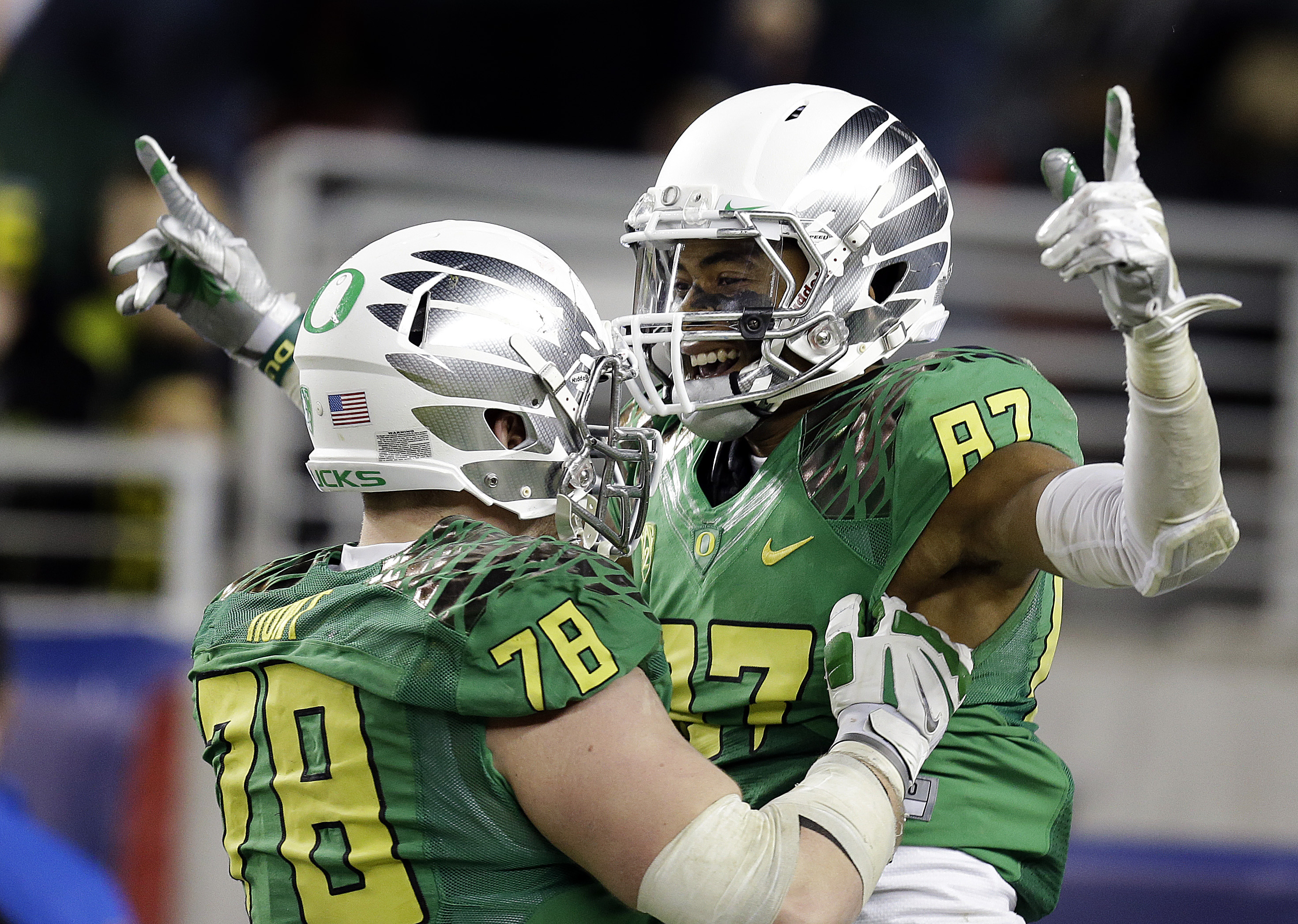 Oregon's Cameron Hunt, left, celebrates a touchdown made by Darren Carrington (87) during the second half of a Pac-12 Conference championship NCAA college football game against Arizona Friday, Dec. 5, 2014, in Santa Clara, Calif. Oregon won the game, 51-13. (AP Photo/Ben Margot)
