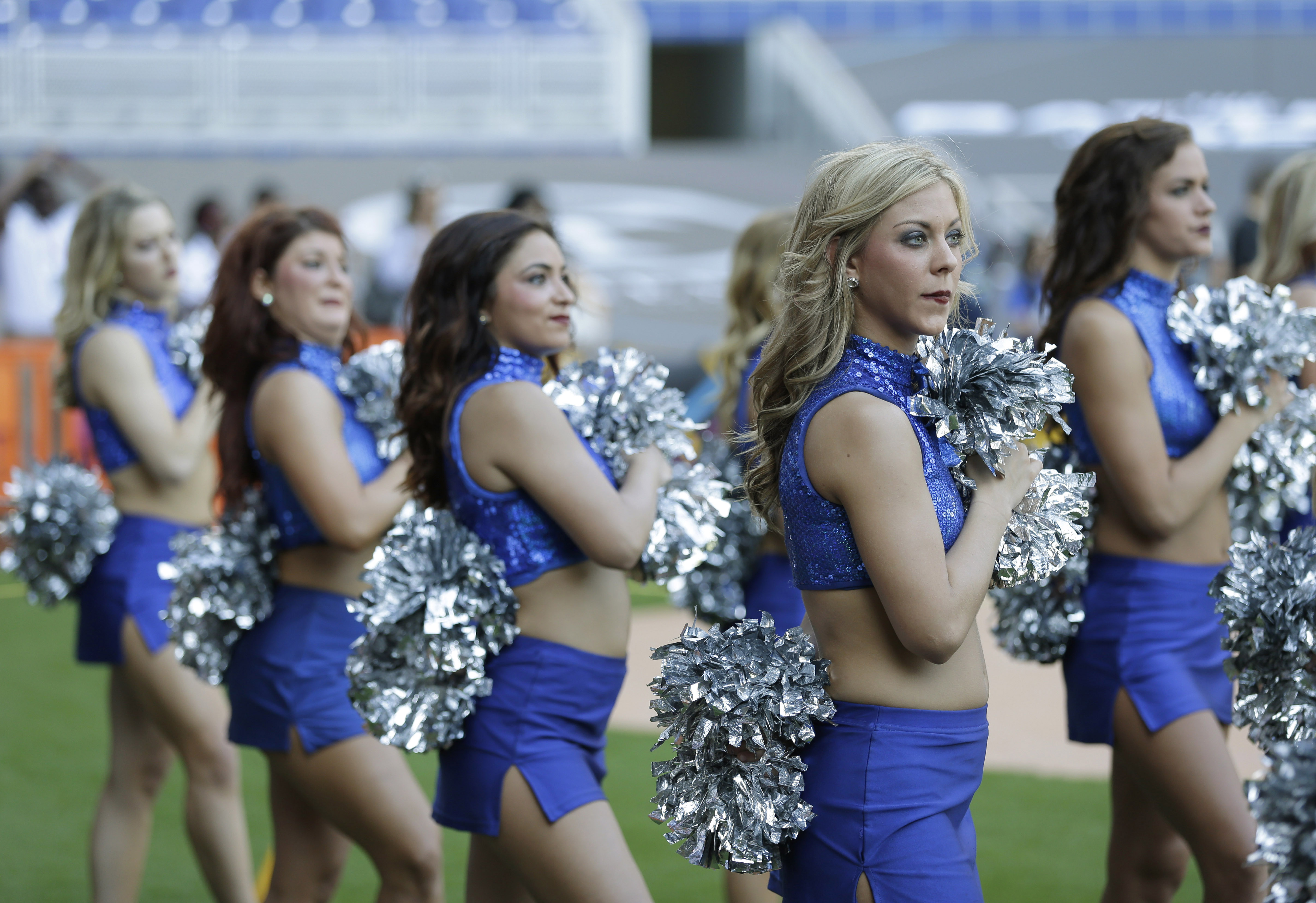 Memphis cheerleaders stand for the singing of the National Anthem before the start of the inaugural Miami Beach Bowl football game between Memphis and Brigham Young, Monday, Dec. 22, 2014 in Miami. (AP Photo/Wilfredo Lee)