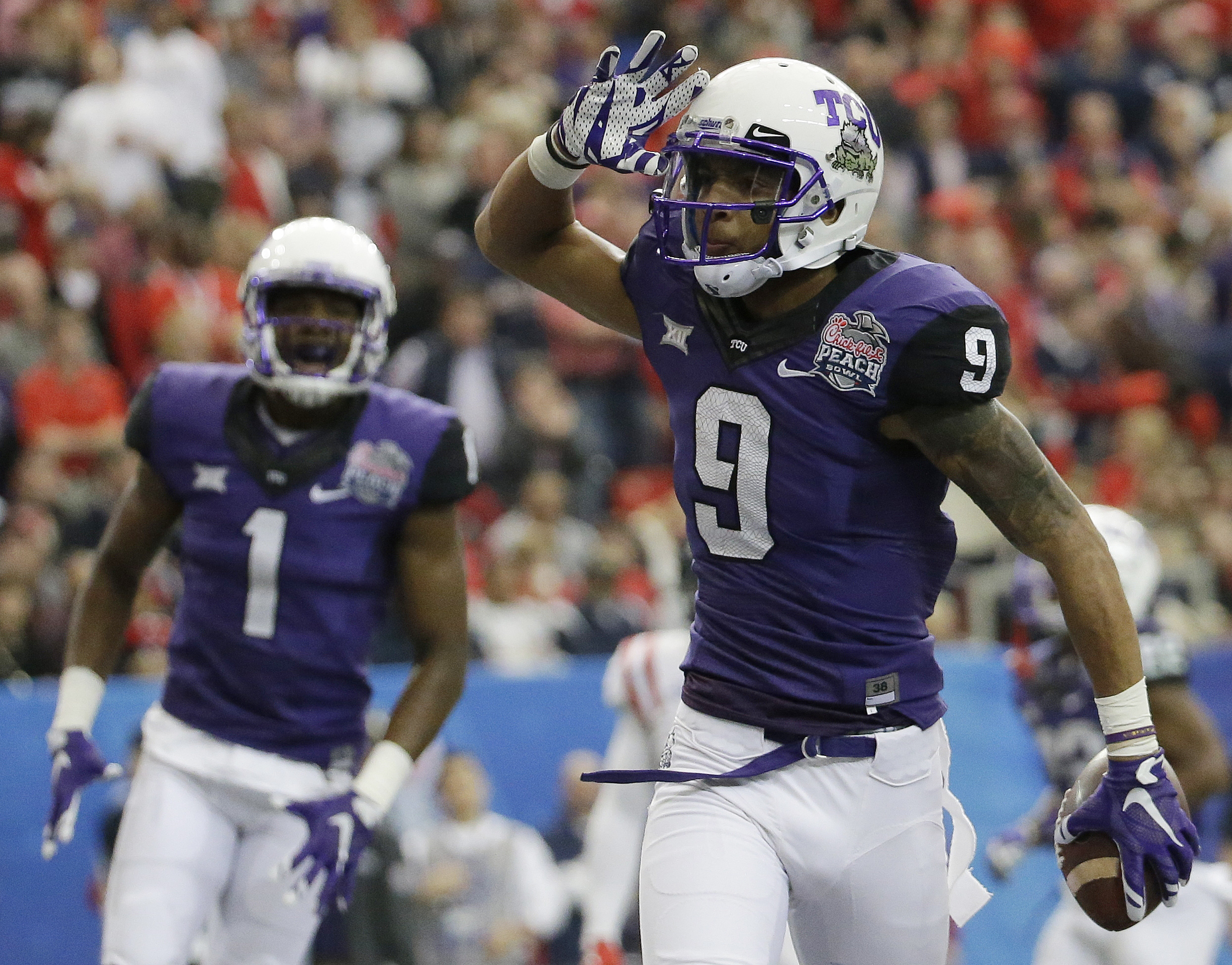 TCU wide receiver Josh Doctson (9) celebrates his touchdown against Mississippi during the first half of the Peach Bowl NCAA football game, Wednesday, Dec. 31, 2014, in Atlanta. (AP Photo/David Goldman)
