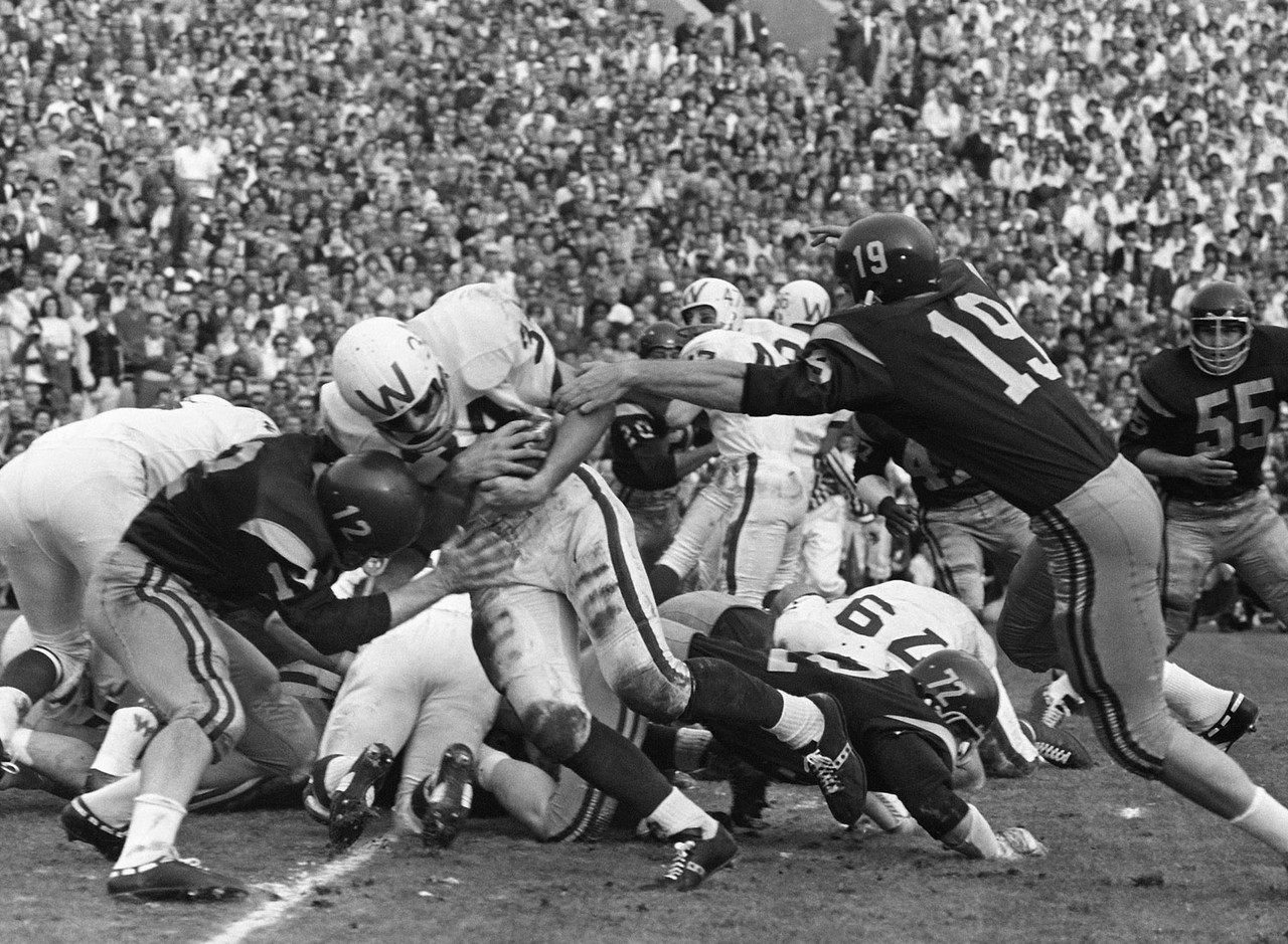 "<b>The result:</b> USC beats Wisconsin, 42-37, for the 1962 national title<br> <b>The skinny:</b> We need to mention the 1963 Rose Bowl here, even though it technically wasn't a title game. That's because back then the final polls came out <i>before</i> the bowls. There was a poll after the bowls in 1965, then not regularly until the 1968 season, when a post-bowls poll became annual. The 1963 Rose Bowl featured No. 1 USC vs. No. 2 Wisconsin, and it was the first 1-2 meeting in a bowl game in history. USC led, 42-14, early in the fourth quarter before Badgers QB Ron VanderKelen caught fire and led a furious rally that fell just short, with <a href=""https://www.youtube.com/watch?v=D2v-UJ3FMBs"" target=""new"">the Trojans prevailing, 42-37</a>."