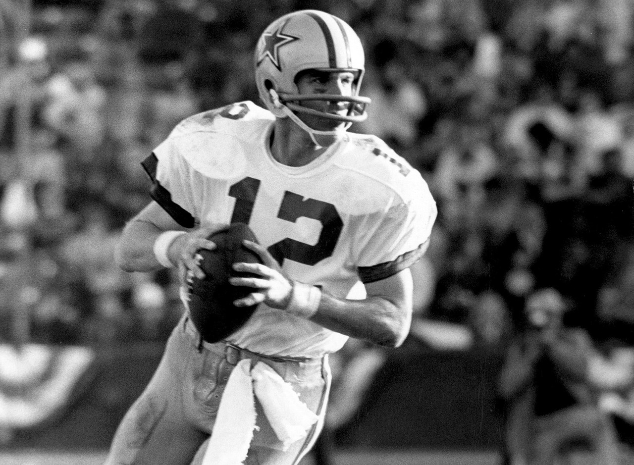 <b>Pro team:</b> Dallas Cowboys (1969-1979).<br><br> At the college level, Staubach starred at Navy, winning the Heisman Trophy in 1963. The Cowboys took him in the 1964 draft, but as a result of his Navy service obligations and a tour of duty in Vietnam, he didn't begin his NFL career until 1969. He was 85-29 in the league as a starter, and his NFL resume includes two Super Bowl titles, a Super Bowl MVP, six Pro Bowls and enshrinement in the Pro Football Hall of Fame.