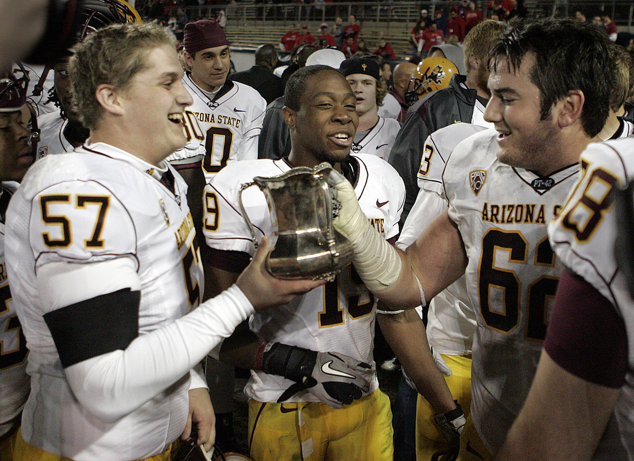 15 For College Footballs Best Rivalry Trophies