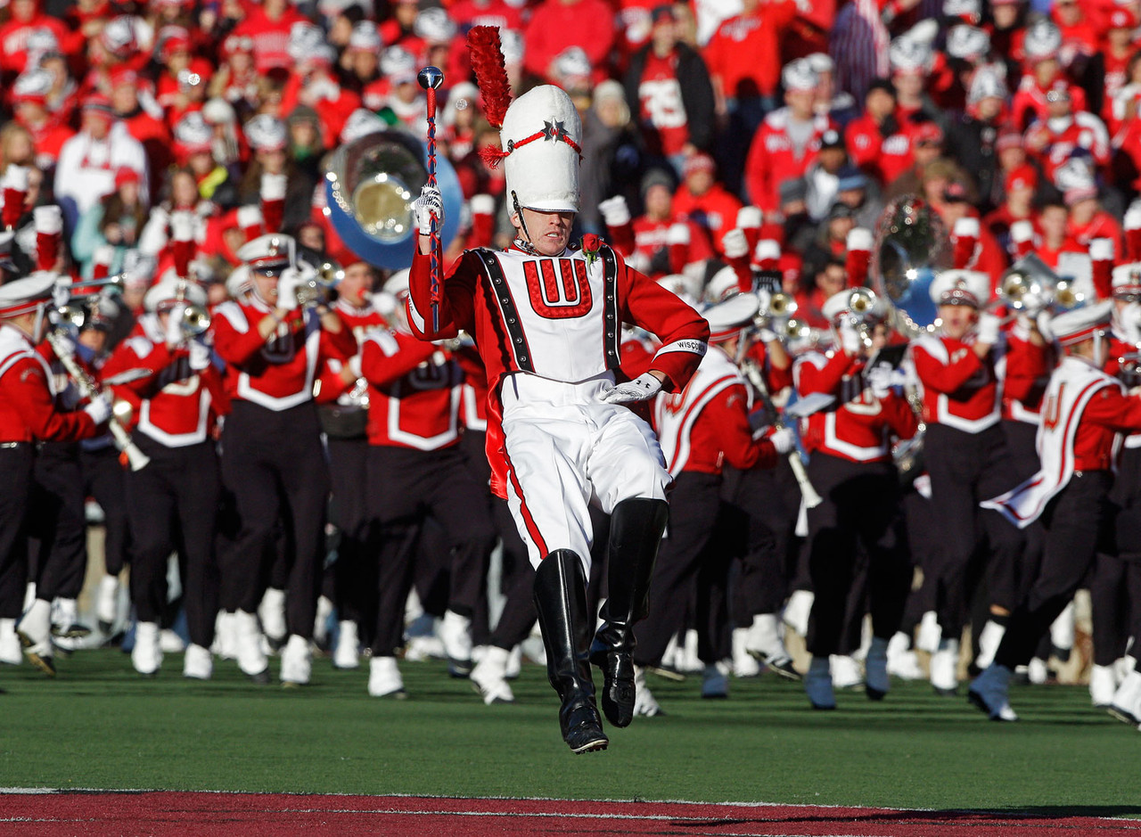 """<b>The song:</b> <a target=""""_blank"""" href=""""http://www.uwbadgers.com/multimedia/on_wis_marching.mp3"""">""""On, Wisconsin!""""</a><br /> <b>The lowdown:</b> A mighty interesting back story, as it was written in 1909 as """"Minnesota, Minnesota"""" because that school was sponsoring a contest looking for a new fight song. But it never was entered, and the lyrics were rewritten to spotlight Wisconsin instead. (With a different set of lyrics, it also is the official state song of Wisconsin.) Random fact: There was a version of the tune done by the Percy Faith orchestra in 1958 on an album called """"Touchdown!"""" The album of college fight songs also includes versions of the tunes ranked 10th, seventh, sixth, fifth, third, second and first on our list. (For those who are so inclined, the album is available on CD.)"""