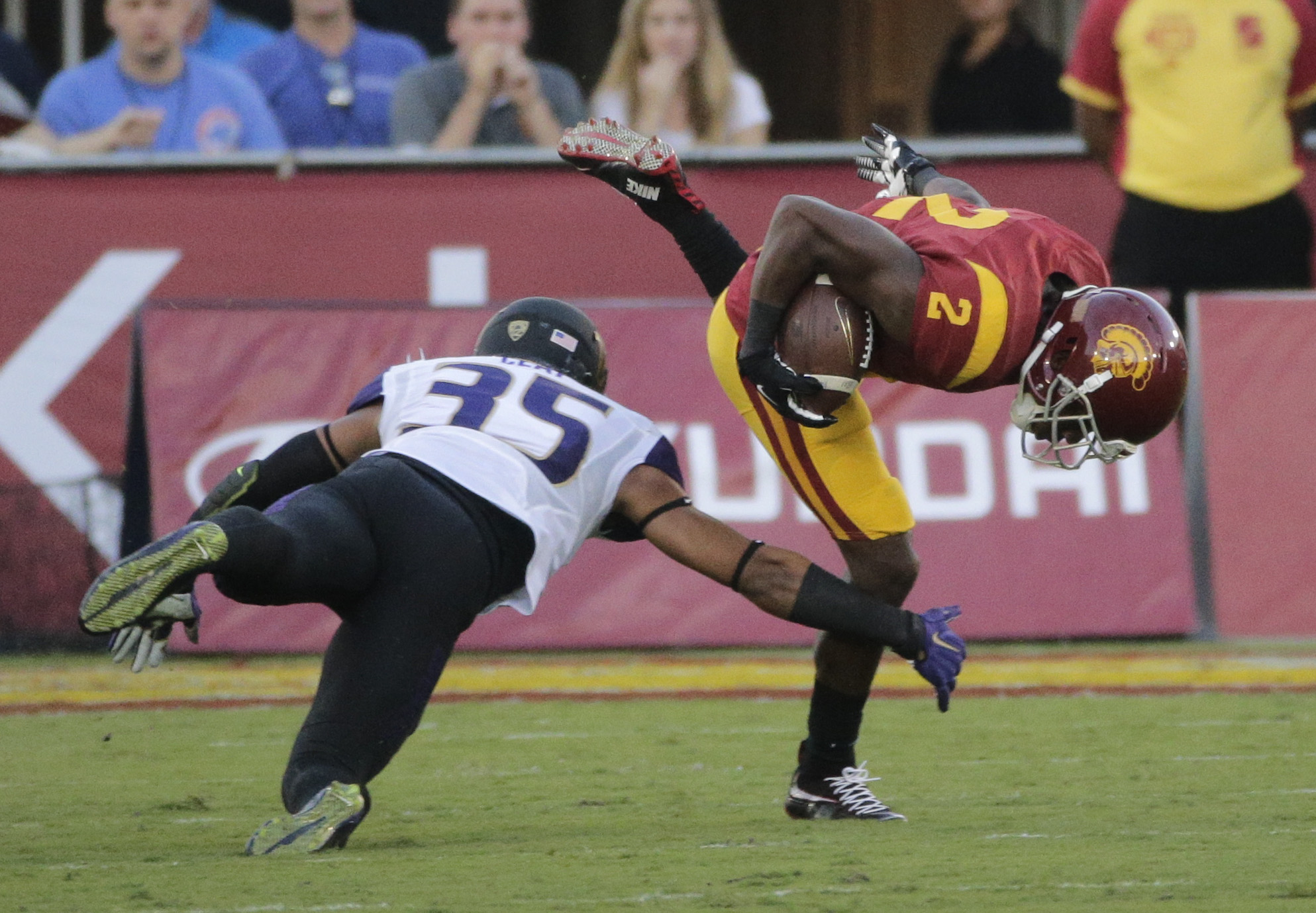 Southern California's Adoree' Jackson, right, avoids a tackle from Washington's Brian Clay during the first half of an NCAA college football game, Thursday, Oct. 8, 2015, in Los Angeles. (AP Photo/Jae C. Hong)