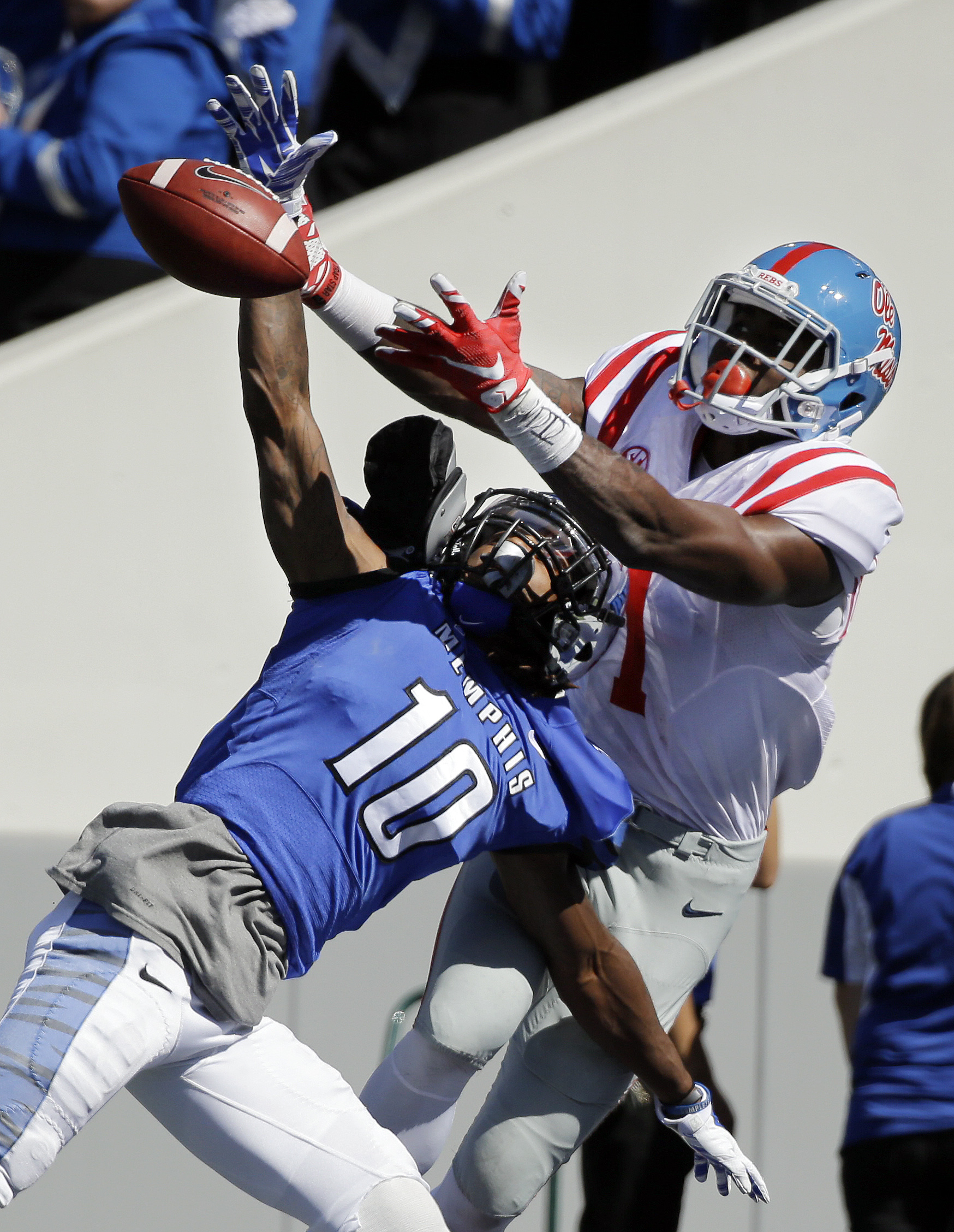 Memphis defensive back Dontrell Nelson (10) breaks up a pass intended for Mississippi wide receiver Laquon Treadwell  (1) in the first half of an NCAA college football game Saturday, Oct. 17, 2015, in Memphis, Tenn. (AP Photo/Mark Humphrey)