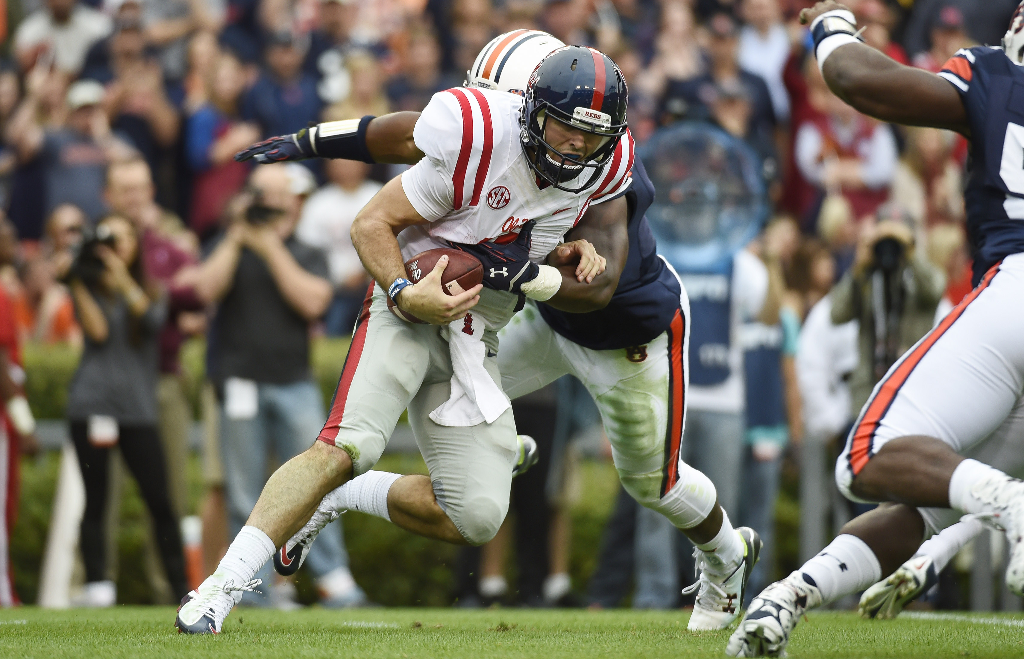 Oct 31, 2015; Auburn, AL, USA; Mississippi Rebels quarterback Chad Kelly (10) is brought down by Auburn Tigers linebacker Cassanova McKinzy (8) during the first quarter at Jordan Hare Stadium. (Shanna Lockwood/USA TODAY Sports)