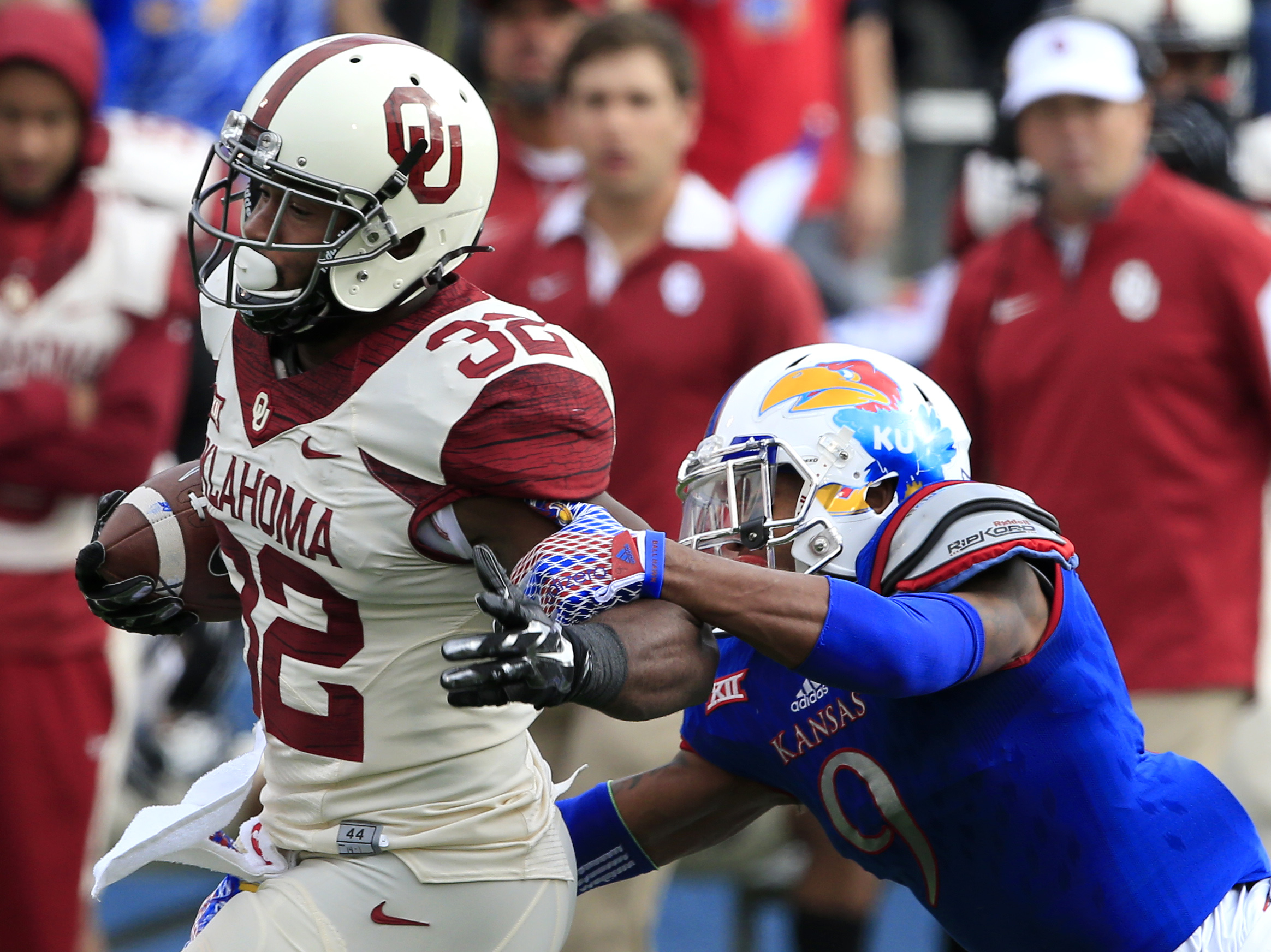 Kansas safety Fish Smithson (9) tackles Oklahoma running back Samaje Perine (32) during the first half of an NCAA college football game in Lawrence, Kan., Saturday, Oct. 31, 2015. (Orlin Wagner/Associated Press)