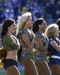 NFL cheerleaders celebrate the Armed Forces