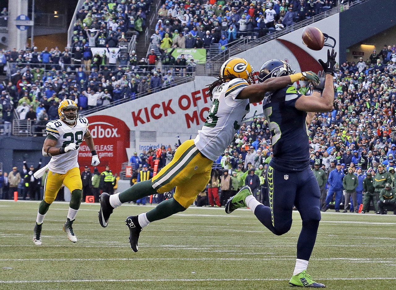 "Jermaine Kearse's <a href=""http://www.nfl.com/videos/seattle-seahawks/0ap3000000460316/Seahawks-game-winning-touchdown"" target=""new"">35-yard touchdown catch</a> in overtime <a href=""http://www.nfl.com/gamecenter/2015011800/2014/POST20/packers@seahawks"" target=""new"">pushed the Seahawks past the Packers</a> and into <a href=""http://www.nfl.com/superbowl/49"" target=""new"">Super Bowl XLIX</a>. The Seahawks rallied from a 16-0 deficit in the first half to earn a second consecutive NFC crown. With this win, the Seahawks became the first defending champion to make the Super Bowl in 10 years."